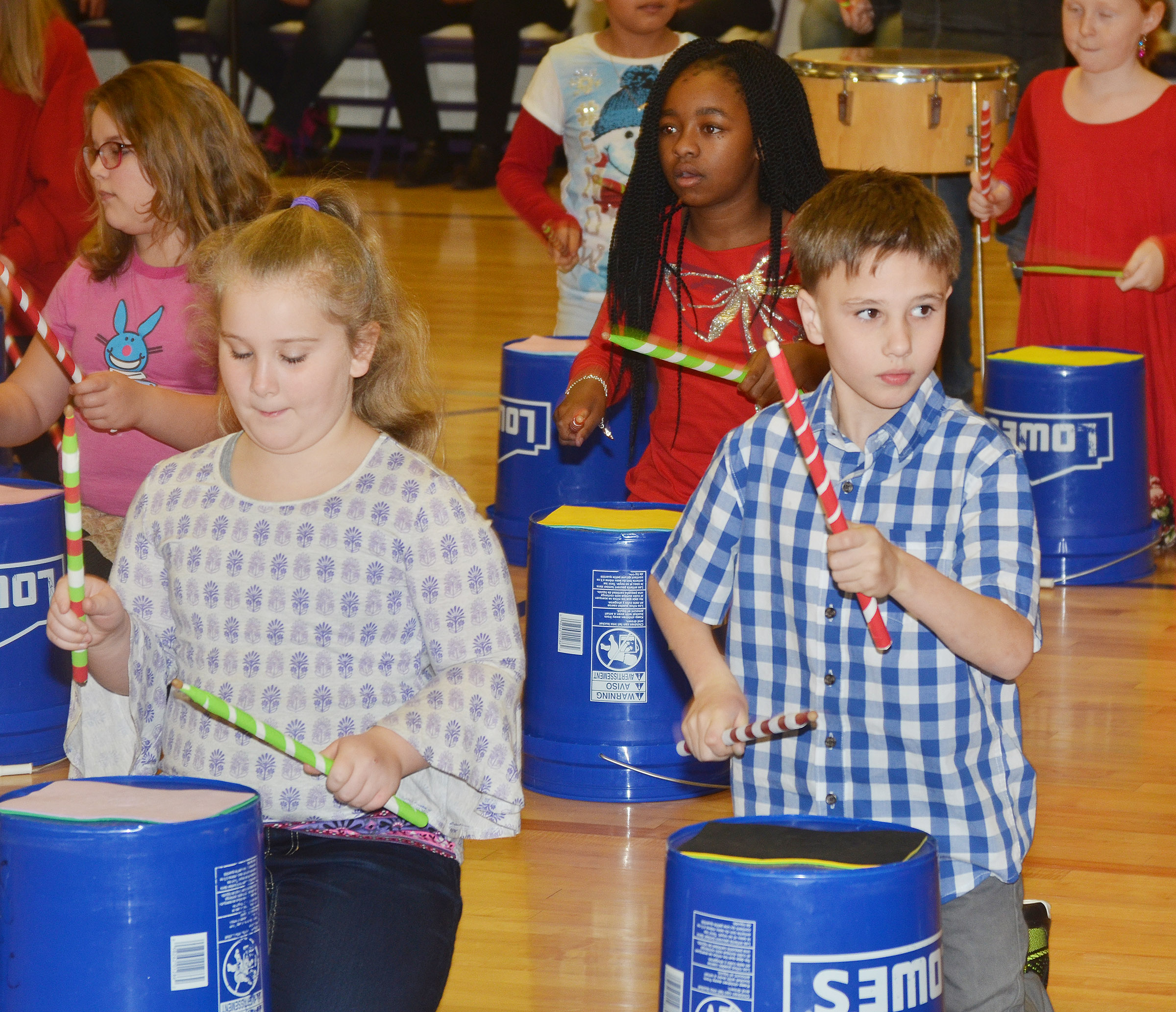 "CES fourth-graders perform ""Run, Run, Rudolph."" In front are Kiera Bailey, at left, and Jayden Harris. Back, Eleana Brewer, at left, and Tiffani Gaddie."