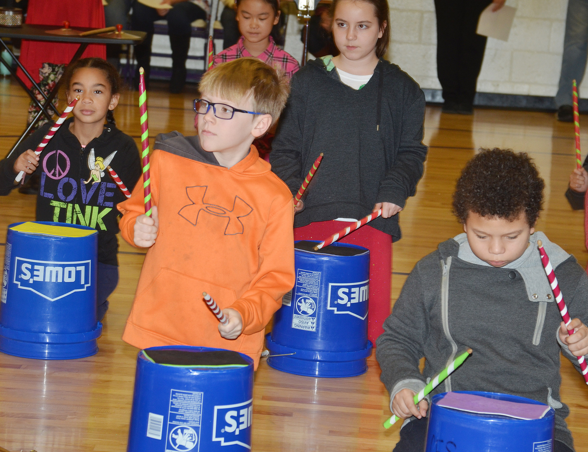 "CES fourth-graders perform ""Run, Run, Rudolph."" In front are Timothy Coots, at left, and Toby Adams. Back, from left, De'Asia Fisher, Demi Hao and Alexis Roddy."
