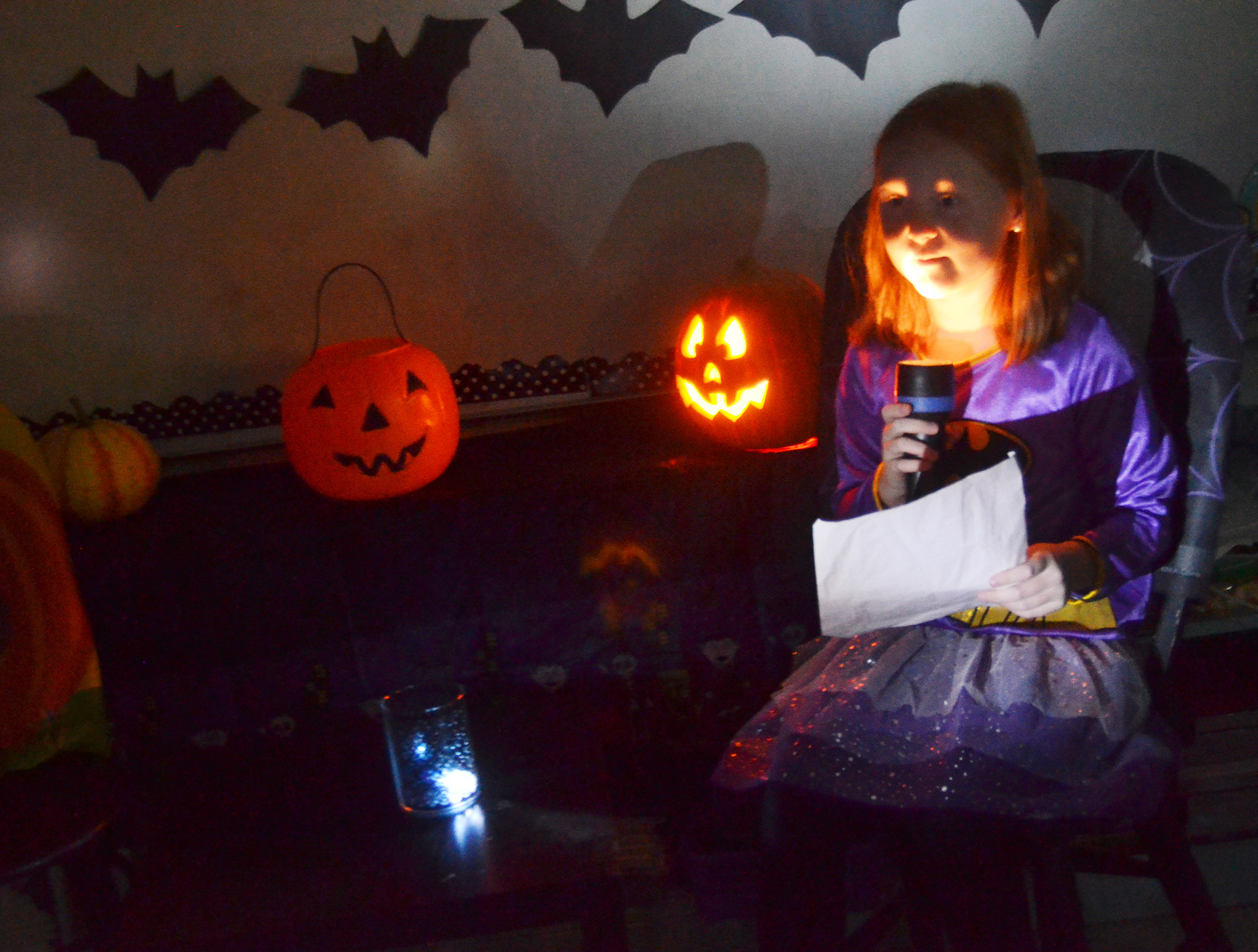 CES fourth-grader Nora Harris reads her spooky story.