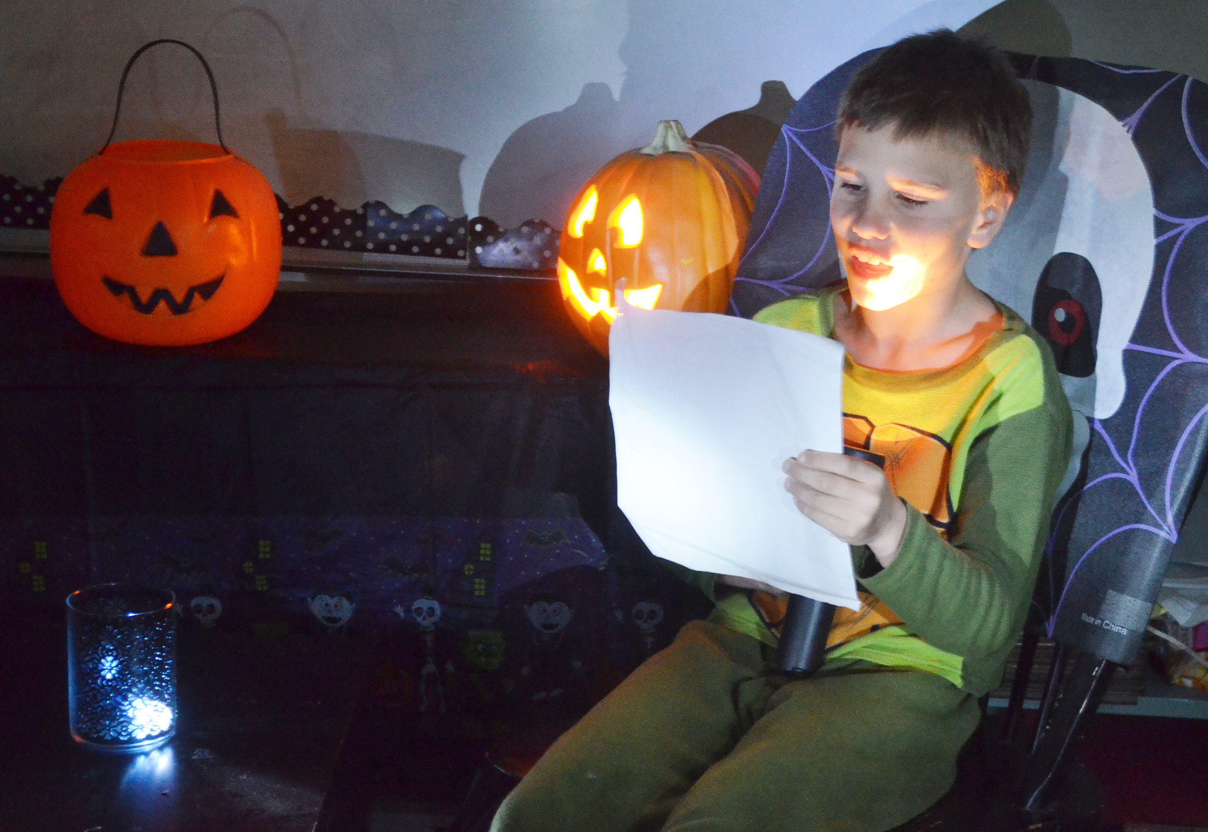 CES fourth-grader Jayden Harris reads his spooky story.