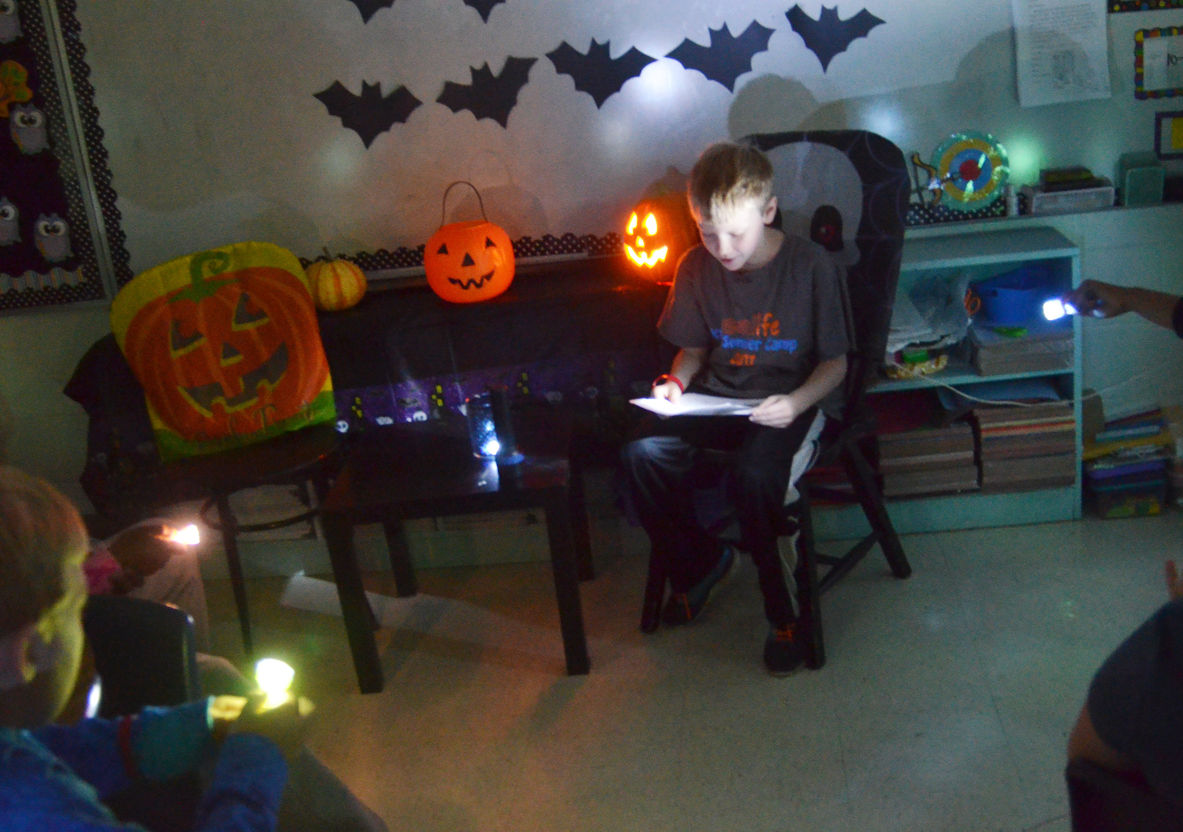 CES fourth-grader Connor Coots reads his spooky story.