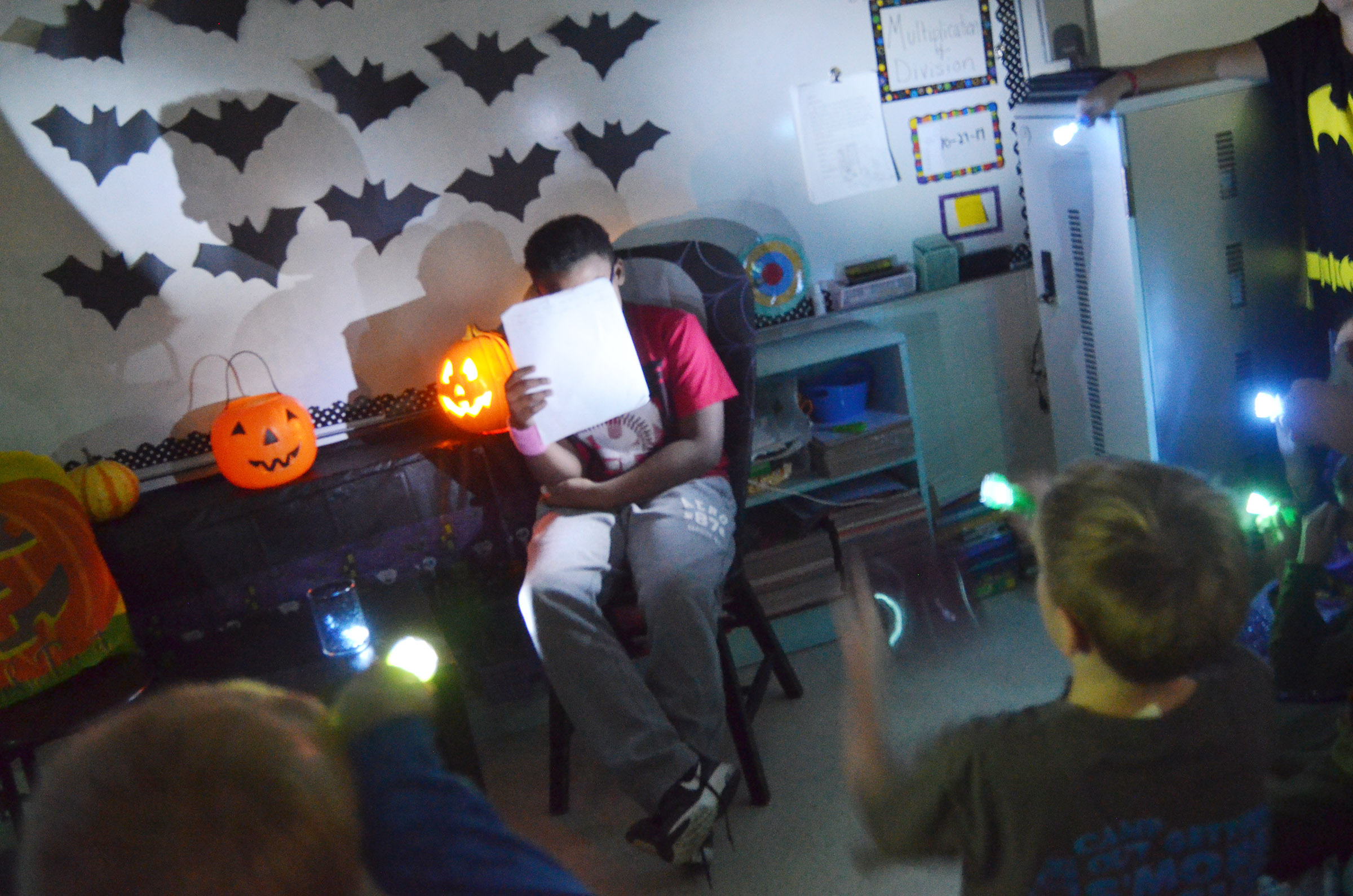 CES fourth-grader Austin Sloan reads his spooky story.
