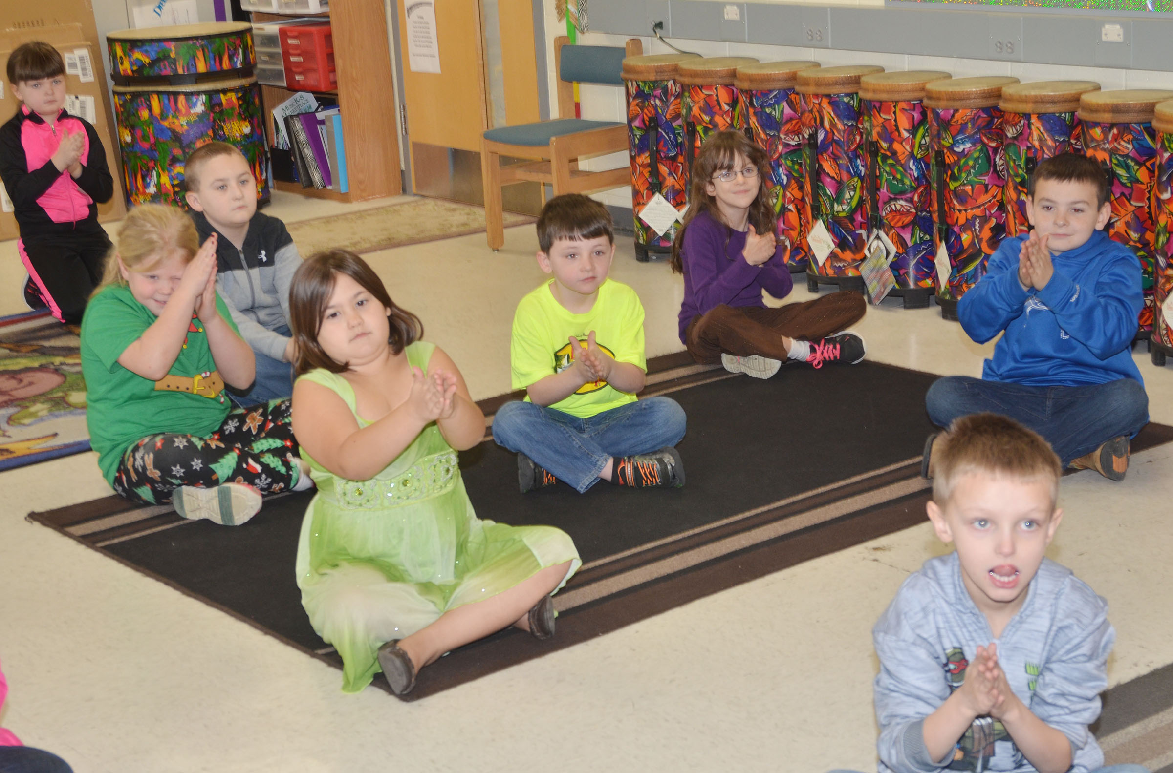 CES second-graders practice clapping rhythms.