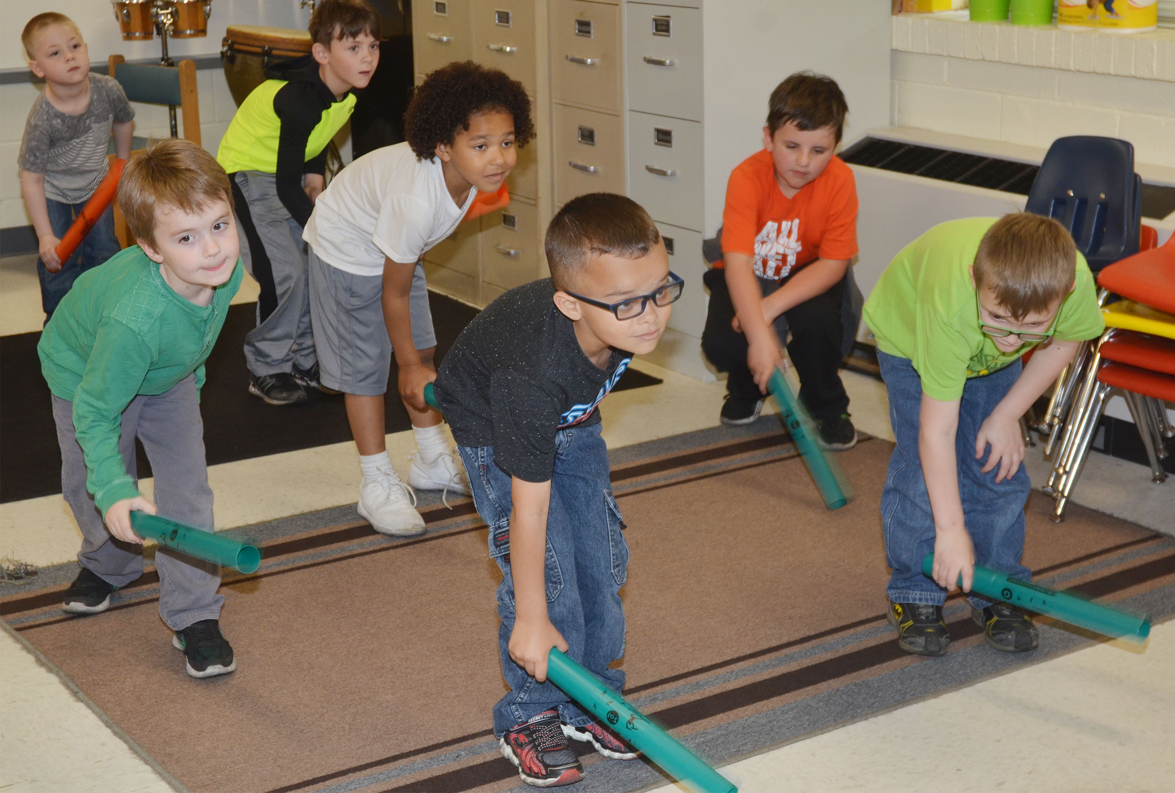 CES kindergarteners play the boom whacker.