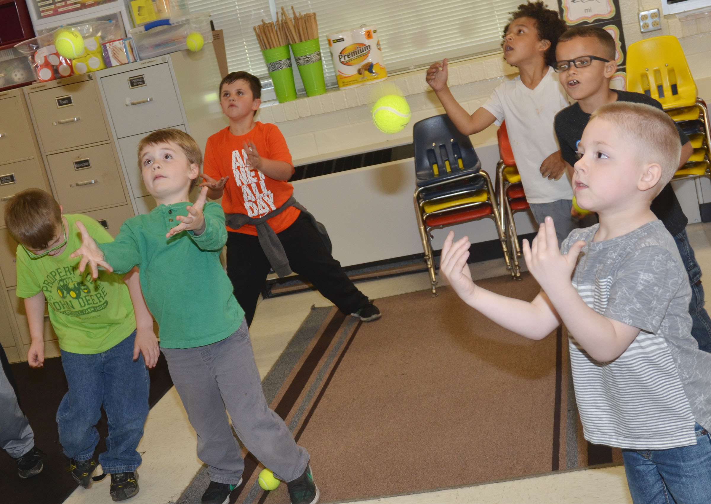 CES kindergartners keep a beat with tennis balls.