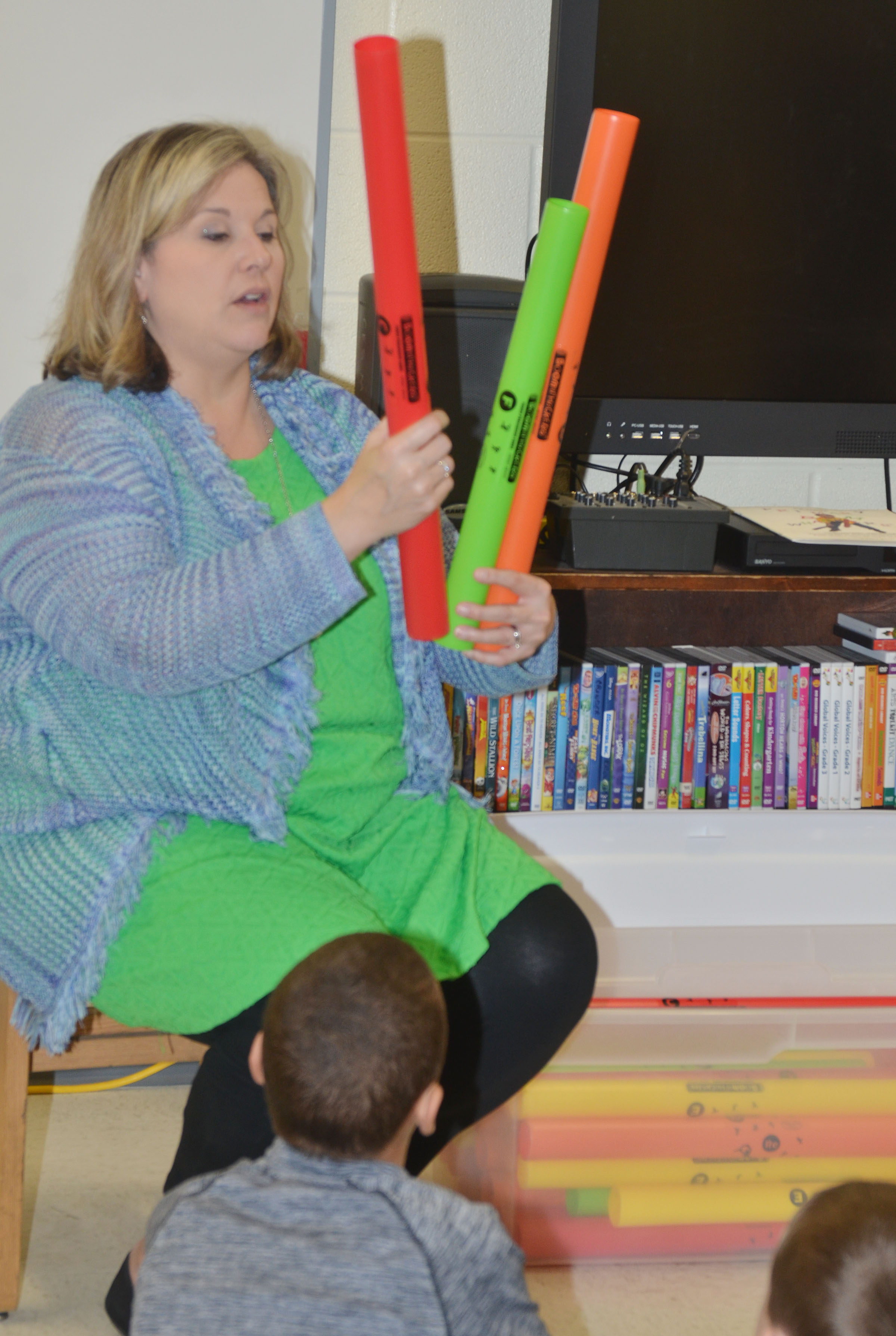 CES music teacher Cyndi Chadwick talks to her students about how to play a boomwhacker.