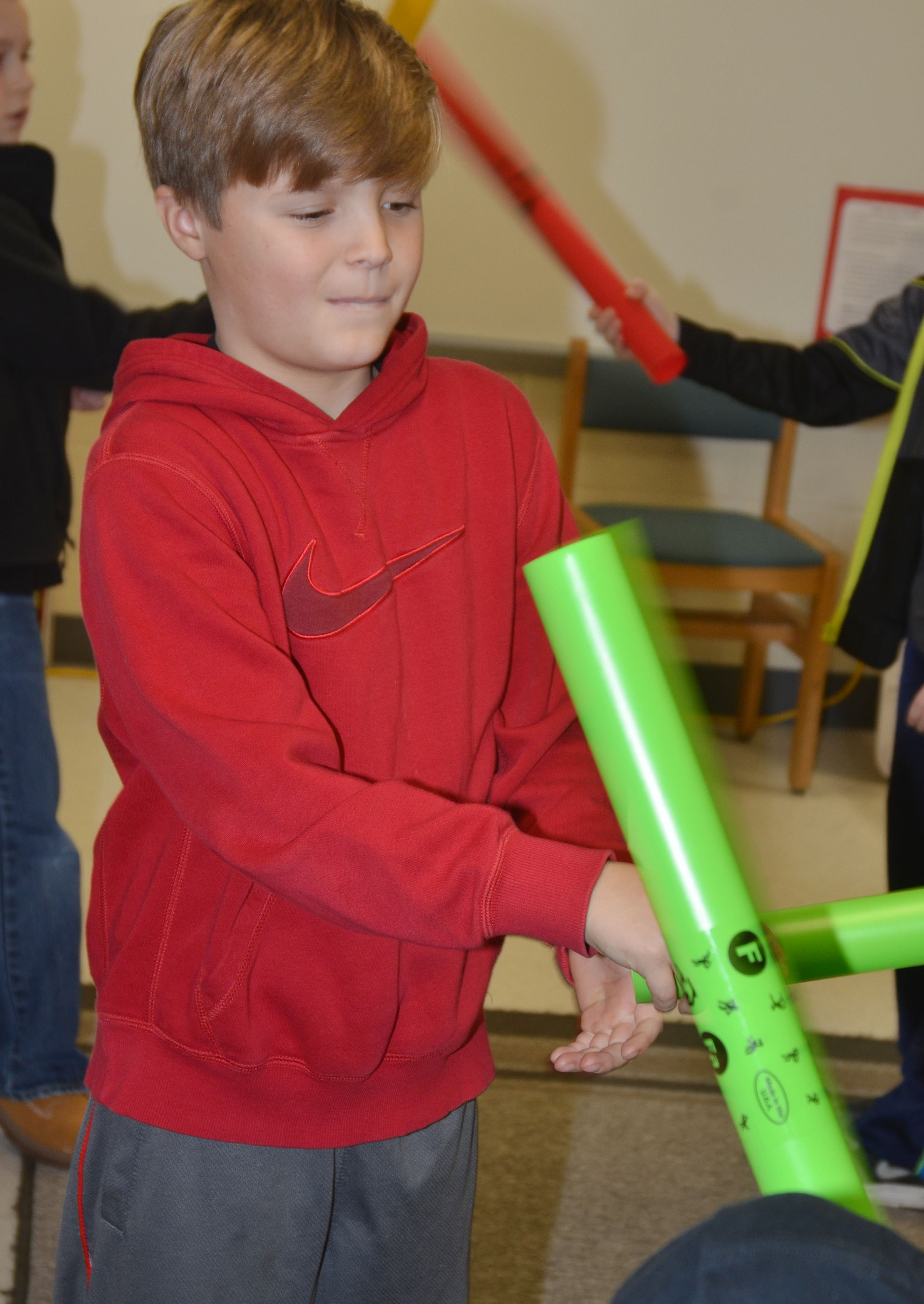 CES second-grader Emerson Gowin plays the boomwhacker.