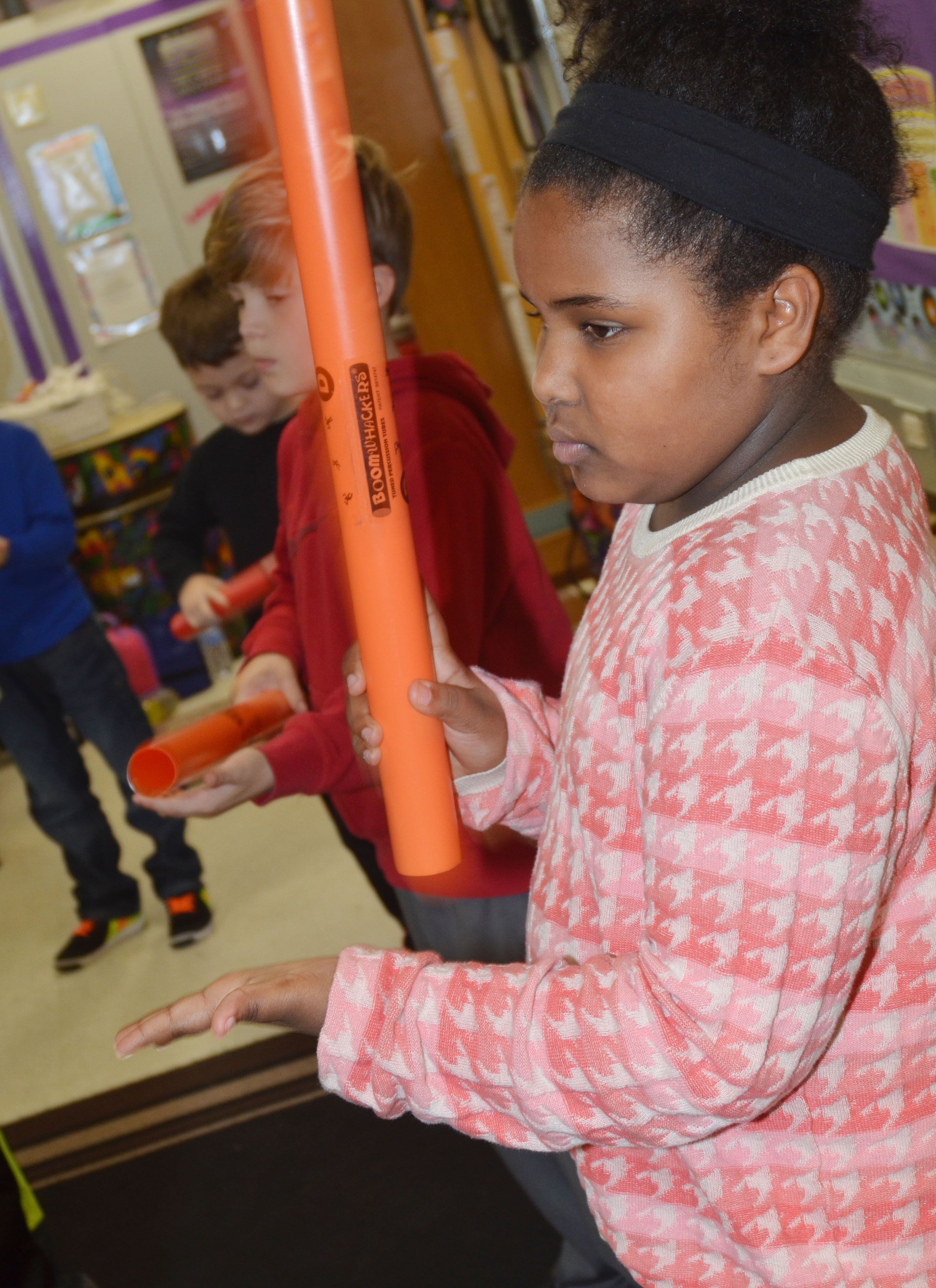 CES second-grader Ajada Smith plays the boomwhacker.