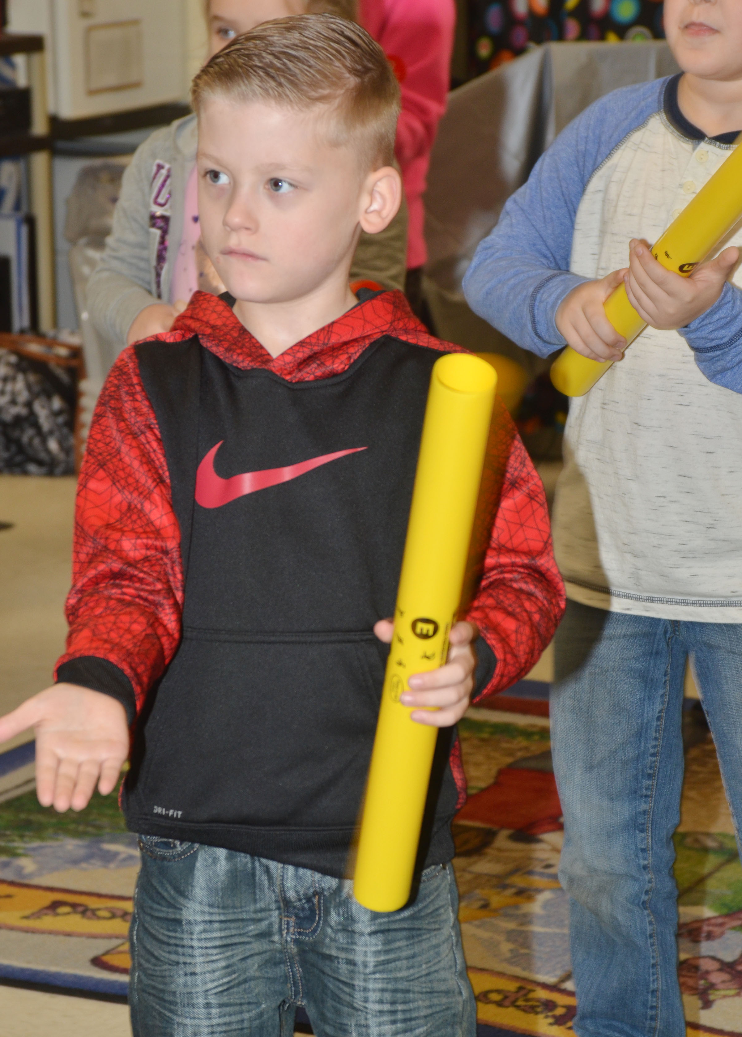 CES second-grader Malachi Sanford plays the boomwhacker.