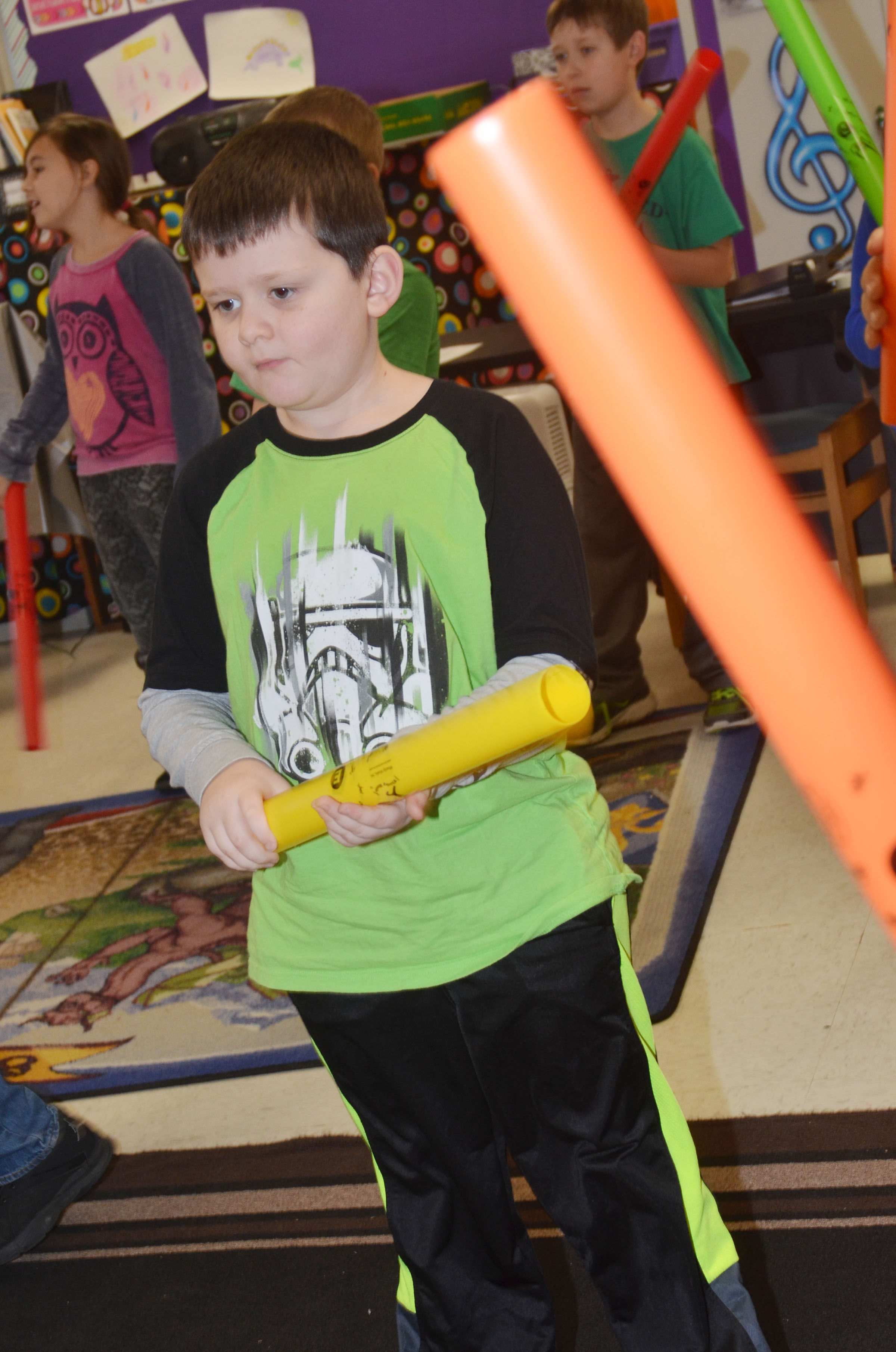 CES second-grader Weston Veltman plays the boomwhacker.