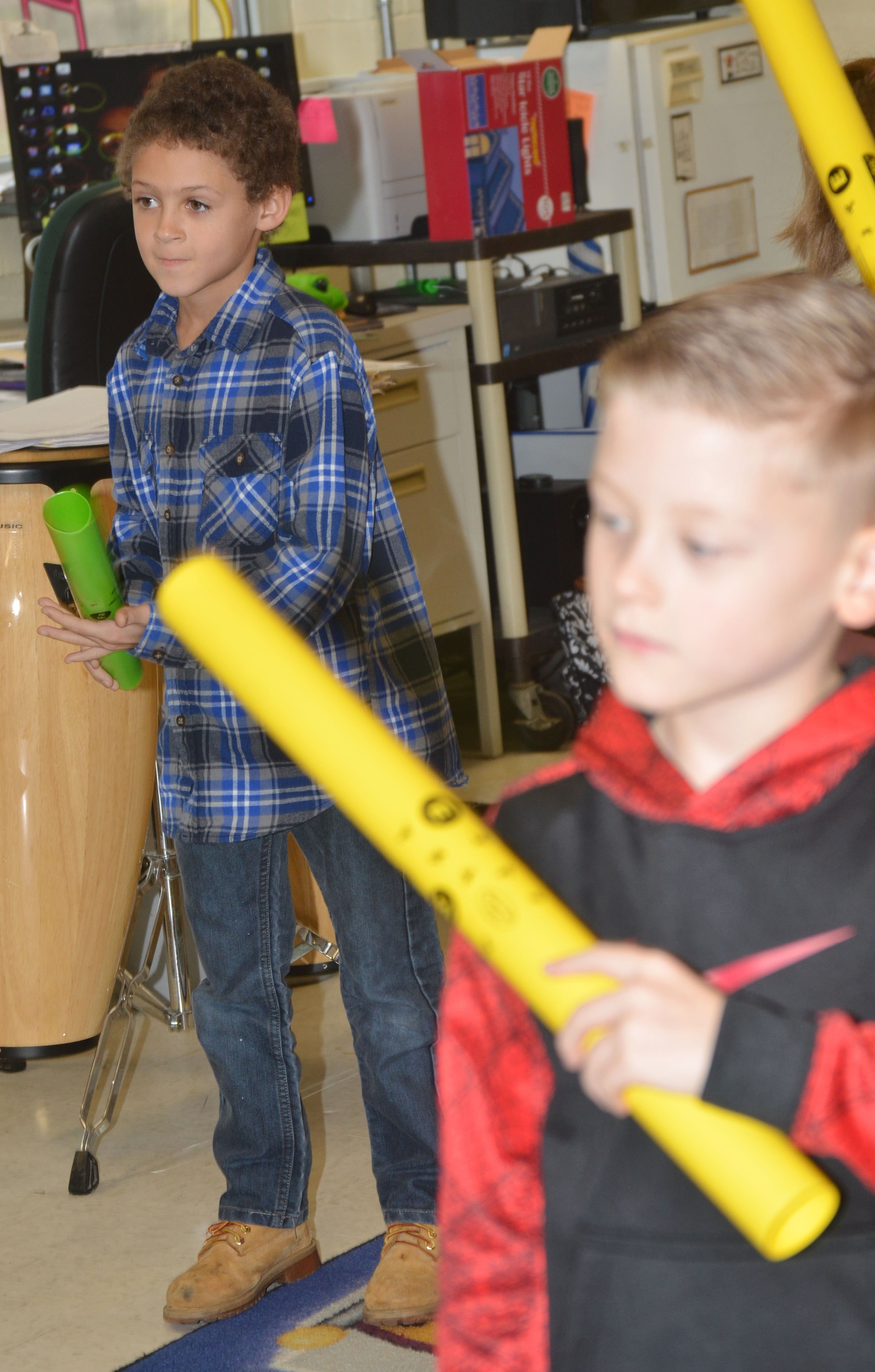 CES second-grader Trever Lasley plays the boomwhacker.