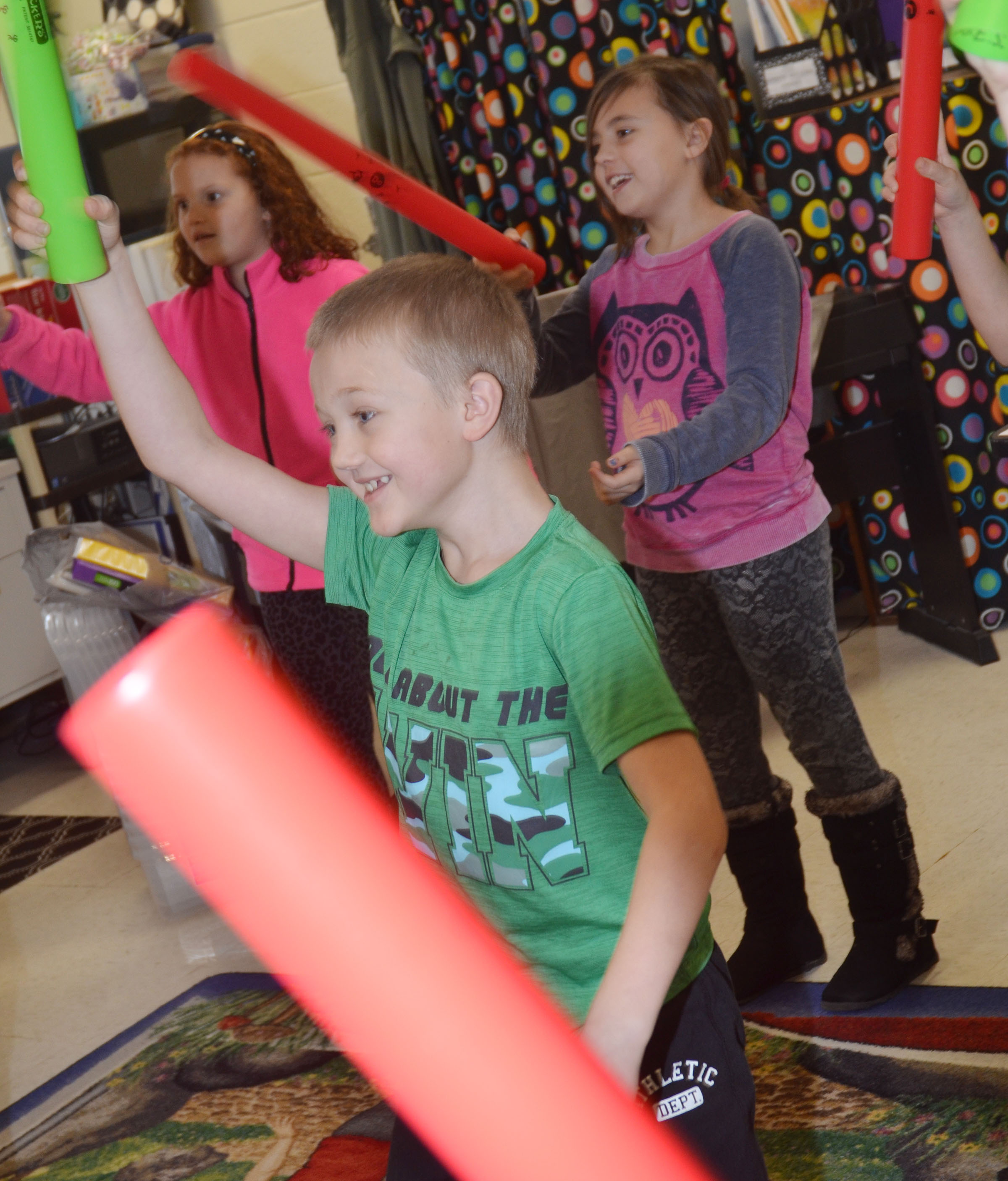 CES second-grader Trenton Harris plays the boomwhacker.