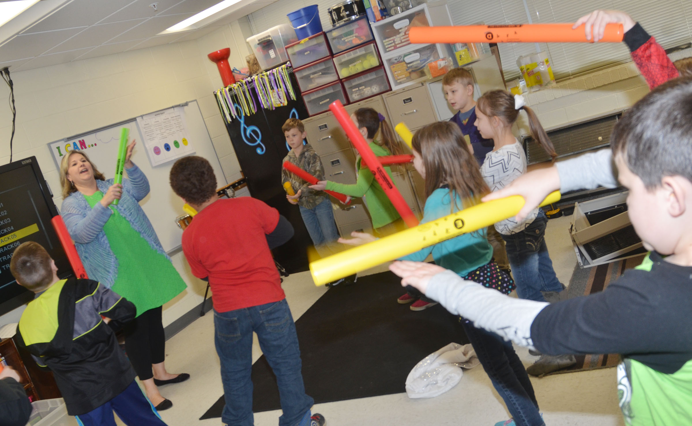"CES music teacher Cyndi Chadwick leads her students in playing ""Meet the Boomwhackers."""