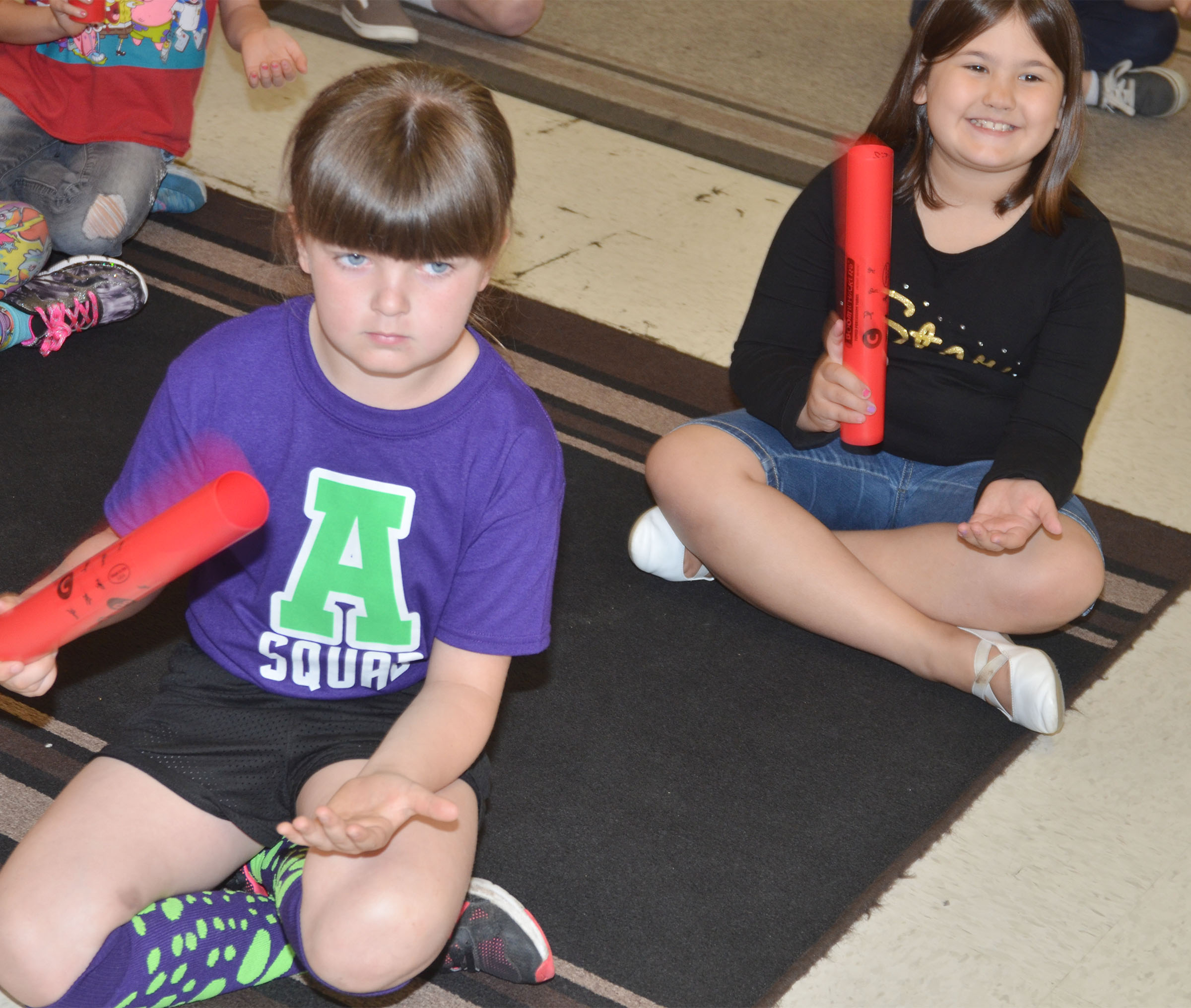 CES second-graders Kaleigh Wilhoite, at left, and Marissa Sumners practice a song with their boomwhackers.