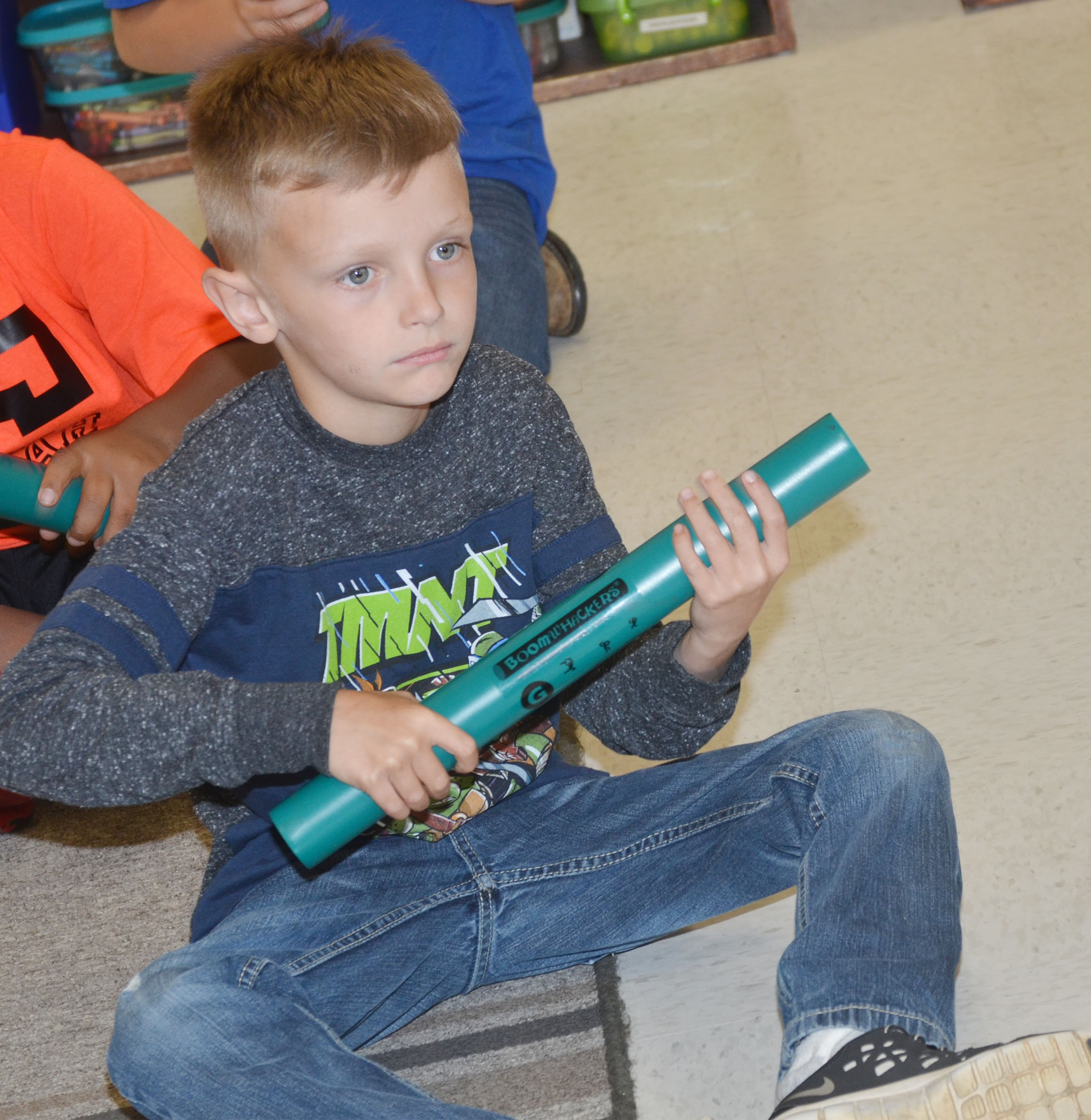 CES second-grader Aaron Ritchie plays a song on his boomwhacker.