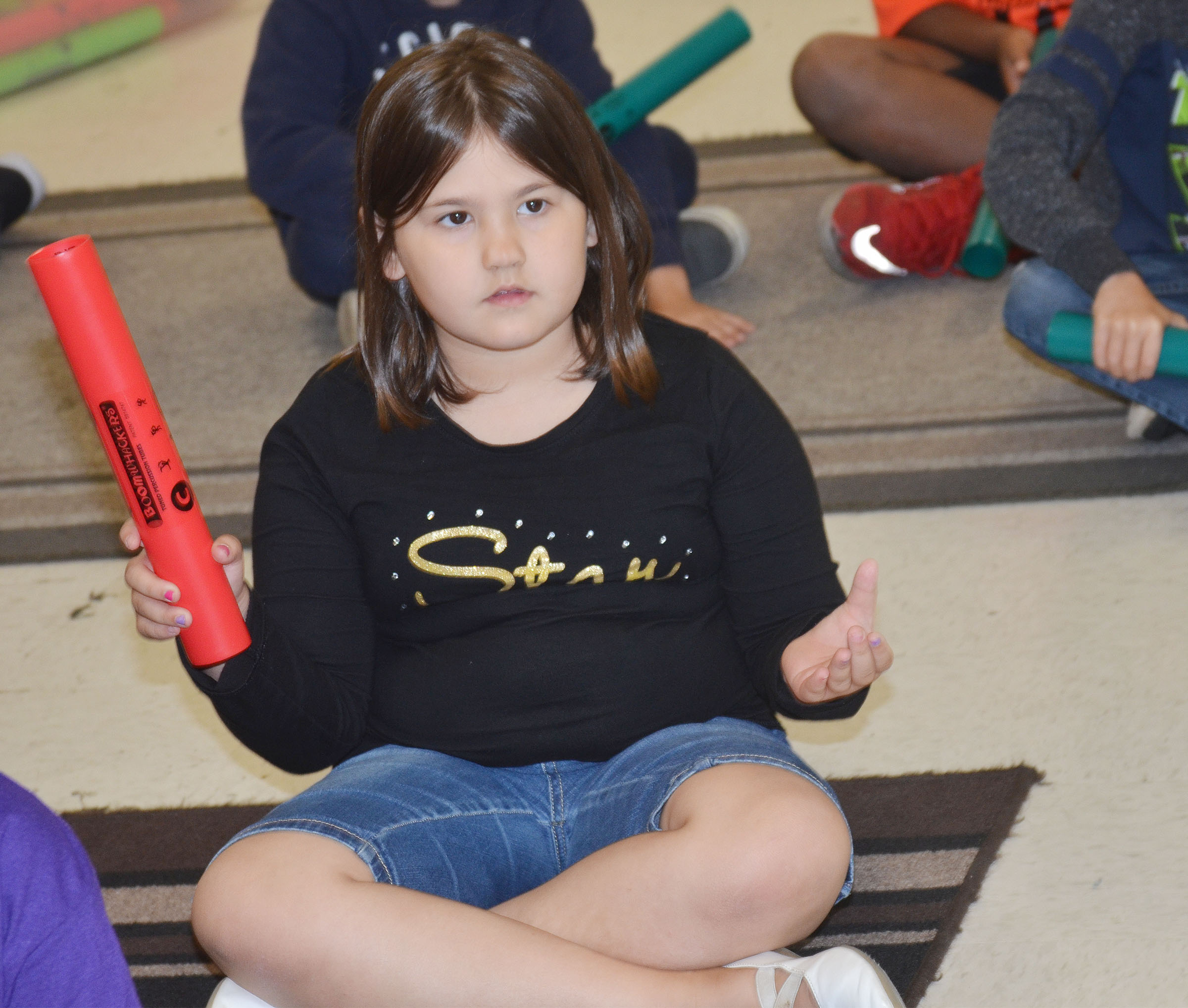 CES second-grader Marissa Sumners practices a song on the boomwhacker.