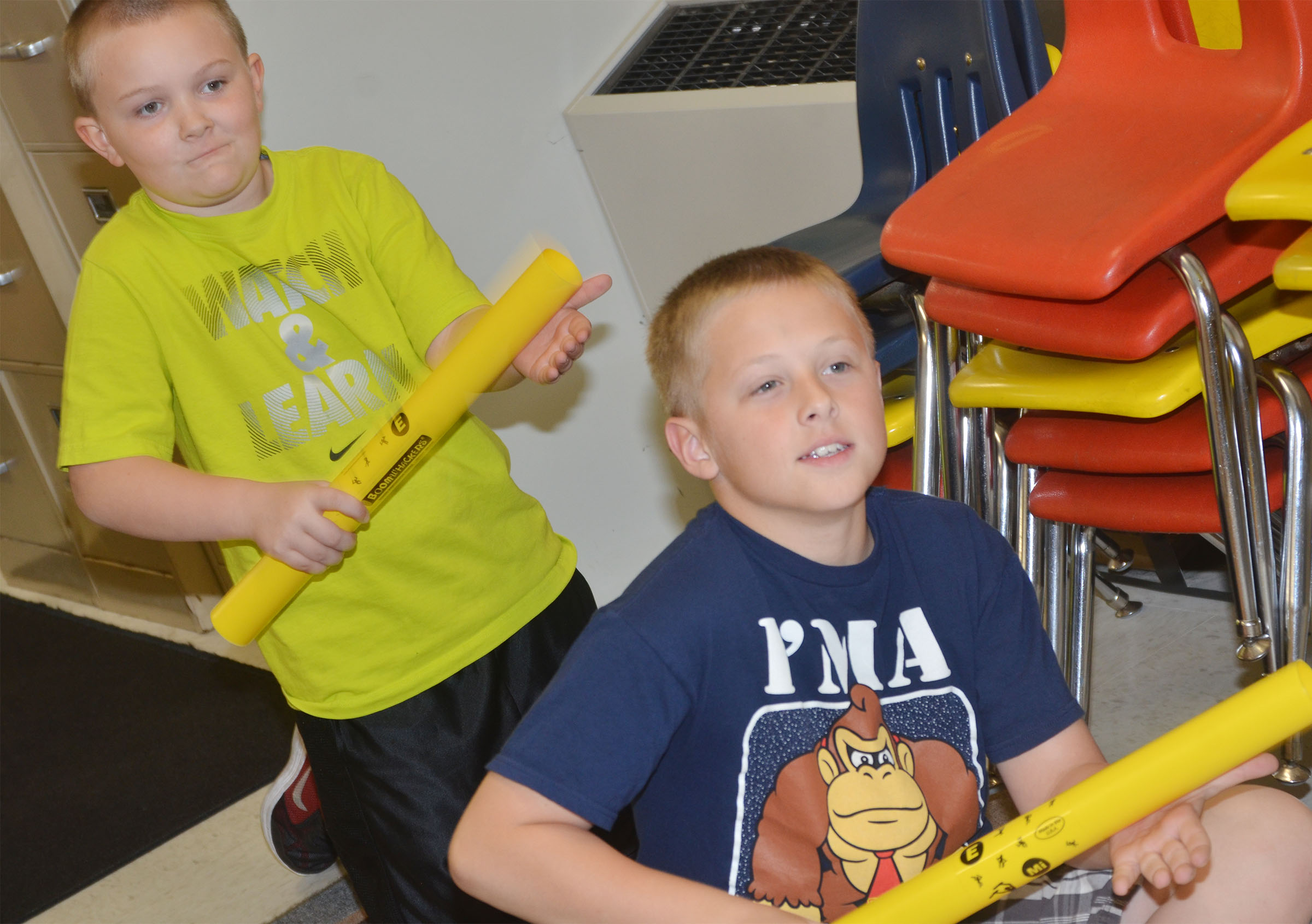 CES second-graders Griffin Skaggs, at left, and Evan Lockridge play a song on the boomwhacker.
