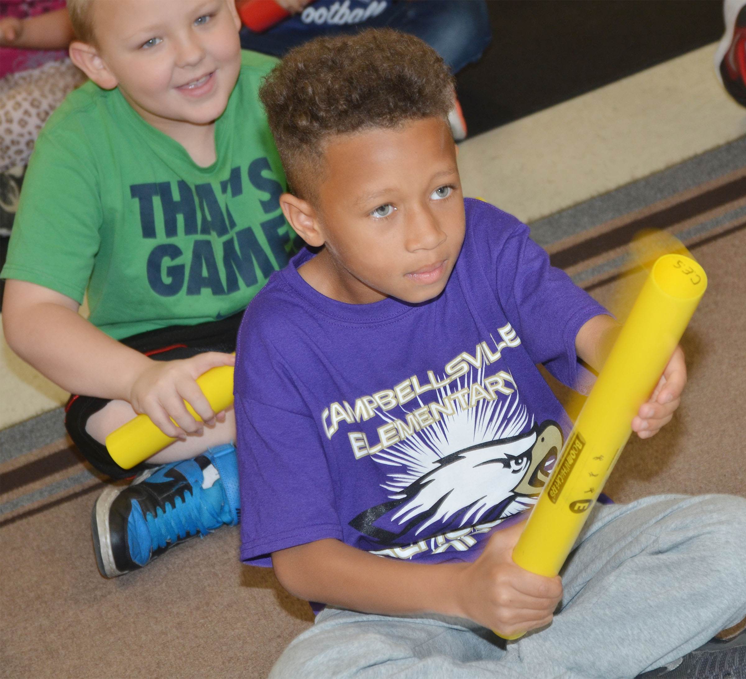 CES second-grader Rajon Taylor plays a song on the boomwhacker.