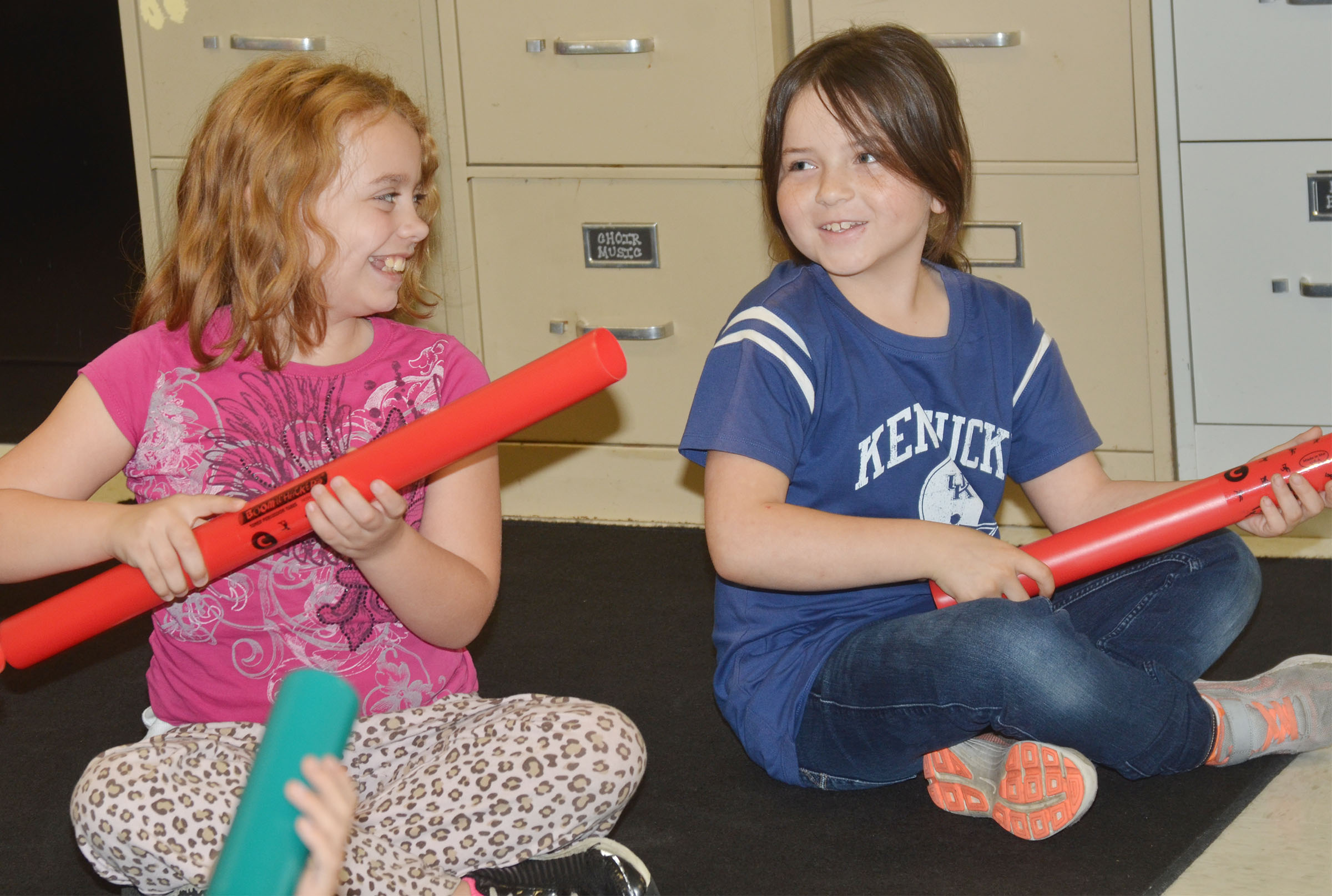 CES second-grader Angelina Babbs, at left, and Kendall Cruz play a song on the boomwhacker.