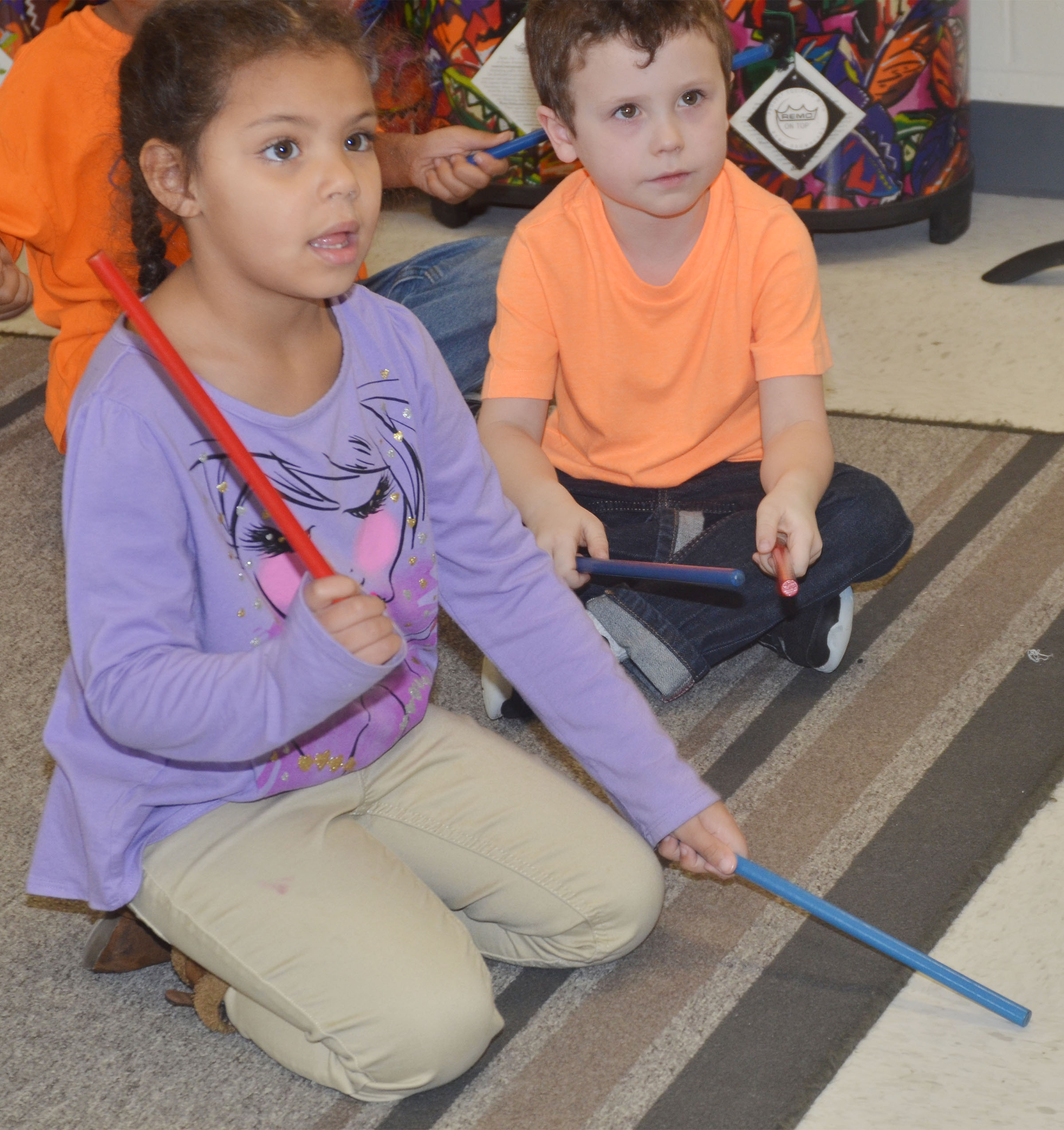 CES kindergarteners Jasymon Musselwhite, at left, and Braydan Dyer play the rhythm sticks.