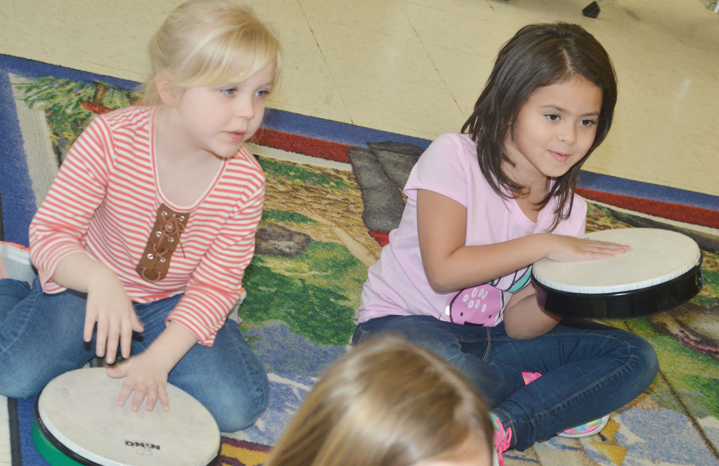 CES kindergarteners Ava Bennett-Marr, at left, and Isabella Anderson play the drums.
