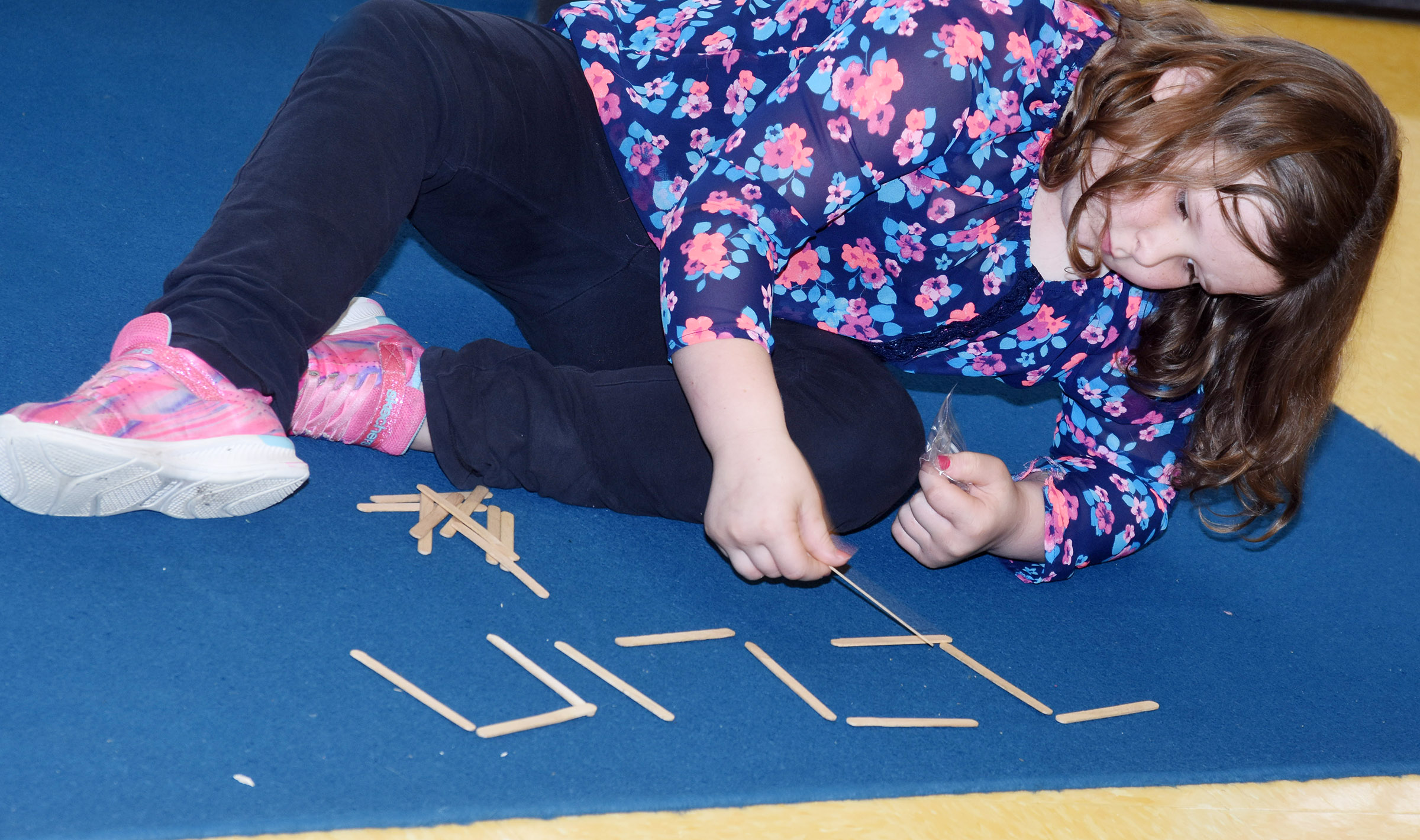 CES third-grader Kierra Maupin writes a rhythm with Popsicle sticks.