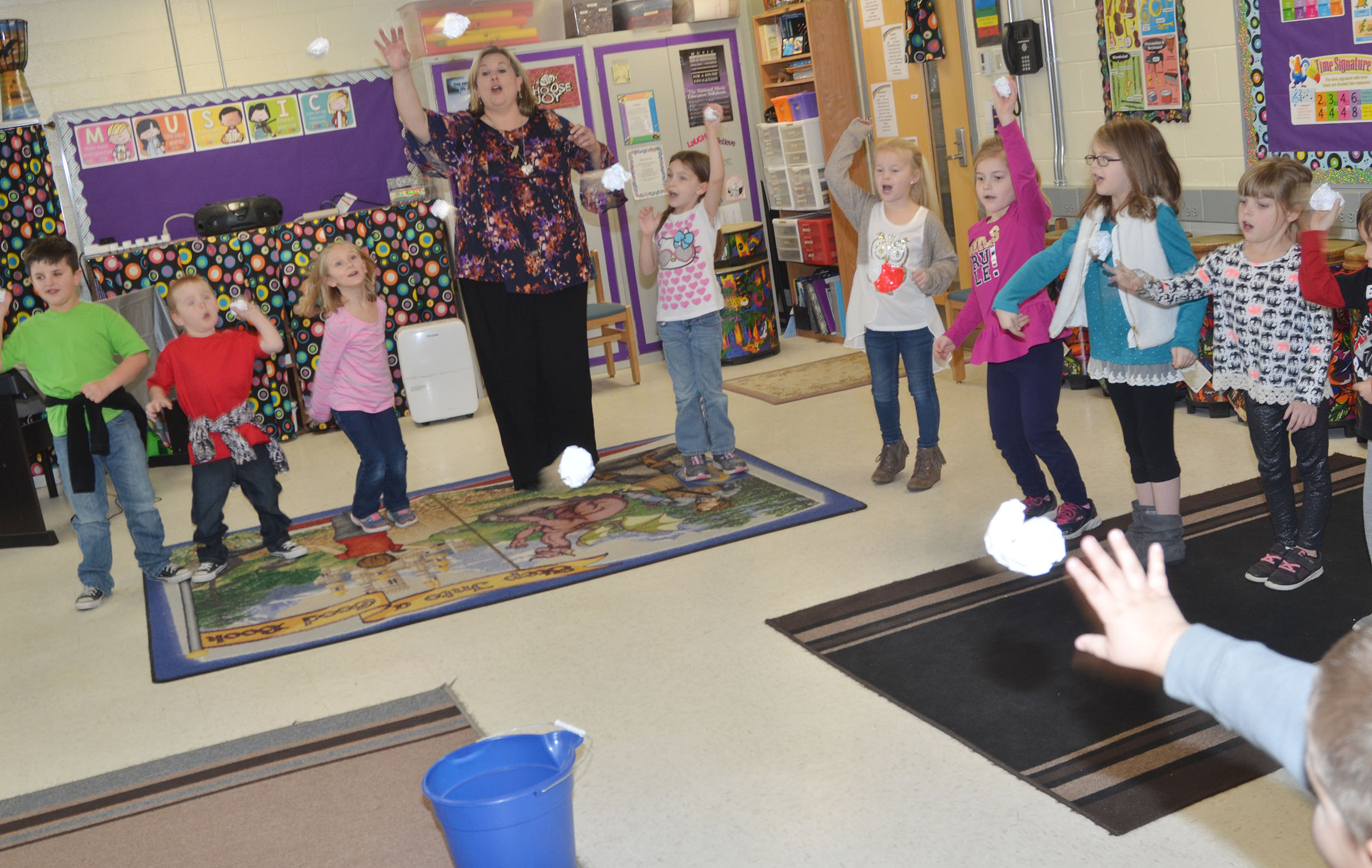 CES kindergarteners throw their snowballs in the bucket at the end of their song.