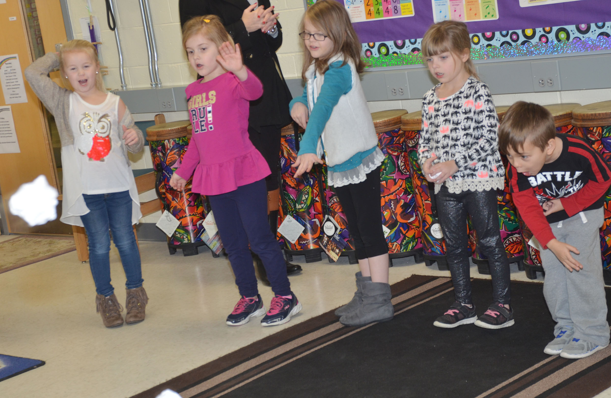 CES kindergarteners throw their snowballs in the bucket at the end of their song. From left are Lillie Judd, Aubreigh Knifley, Zoe Weddle, Madison Wilhoite and Michael Terry.
