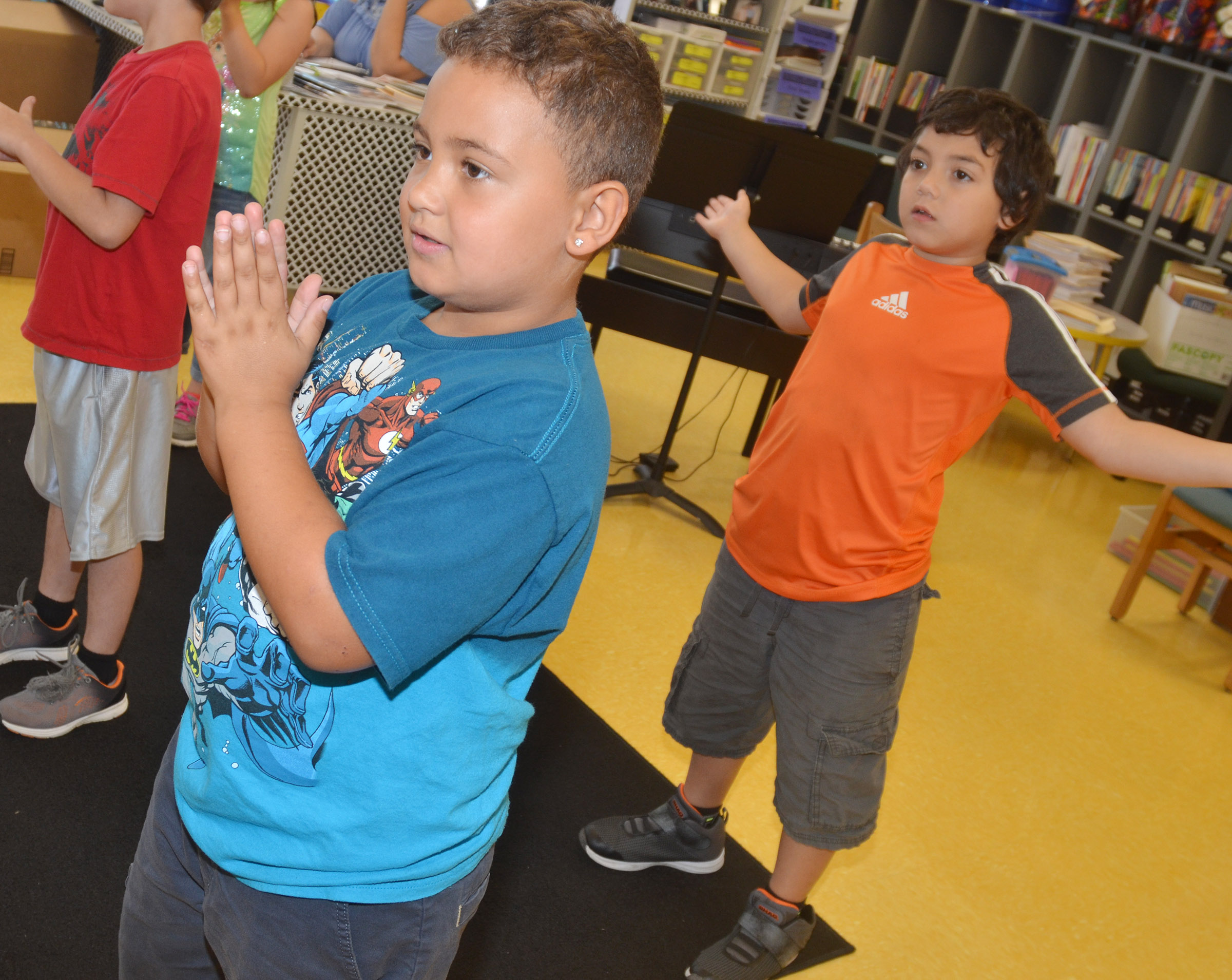 CES second-graders Marion Mann, at left, and Diego Aquino practice keeping a steady beat.