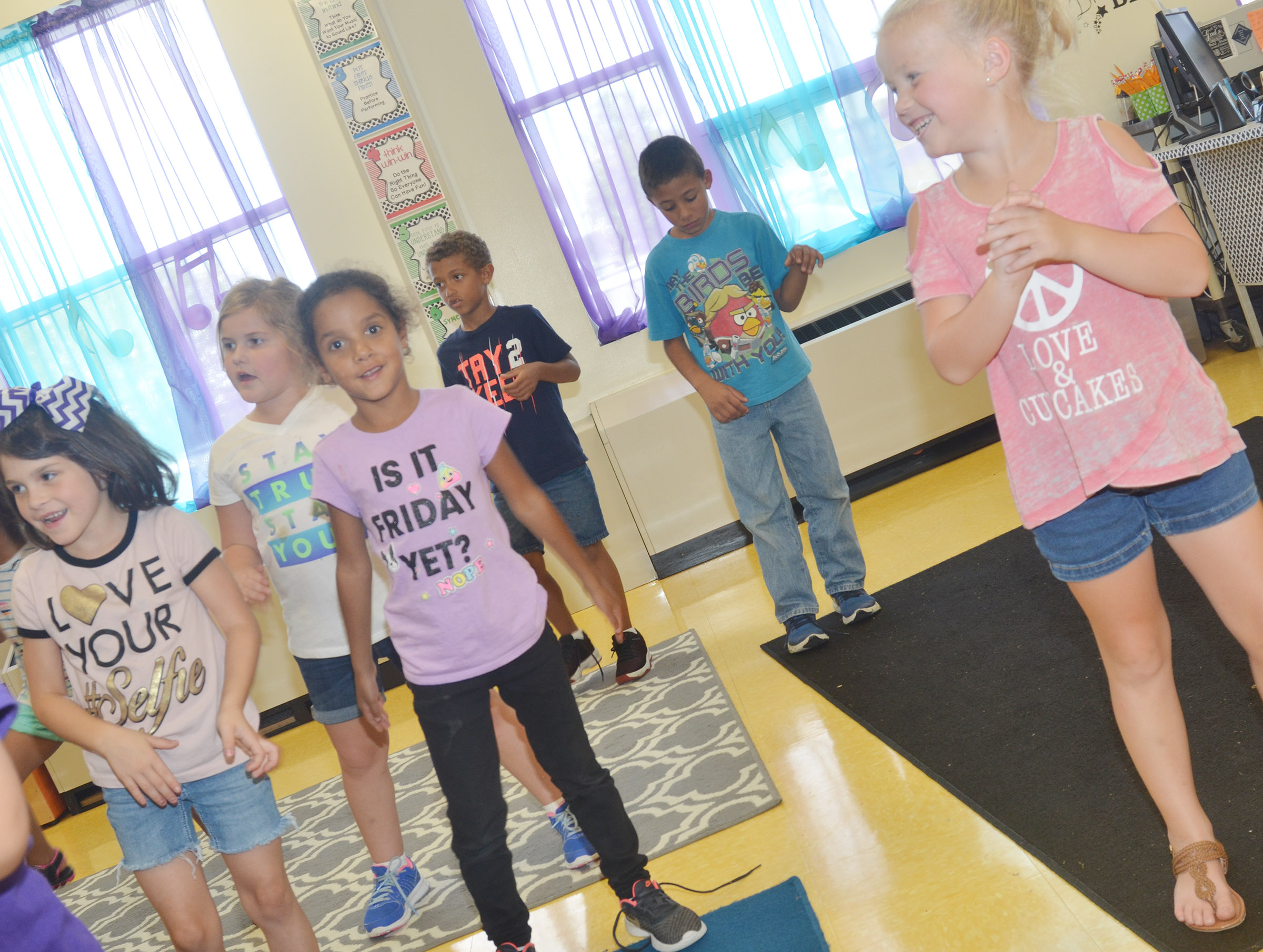CES first-graders, from left, Phoebe Ritchie, Aubreigh Knifley, Kylei Thompson, Tyce Owens, Elijah Williams and Lillie Judd dance to the beat.
