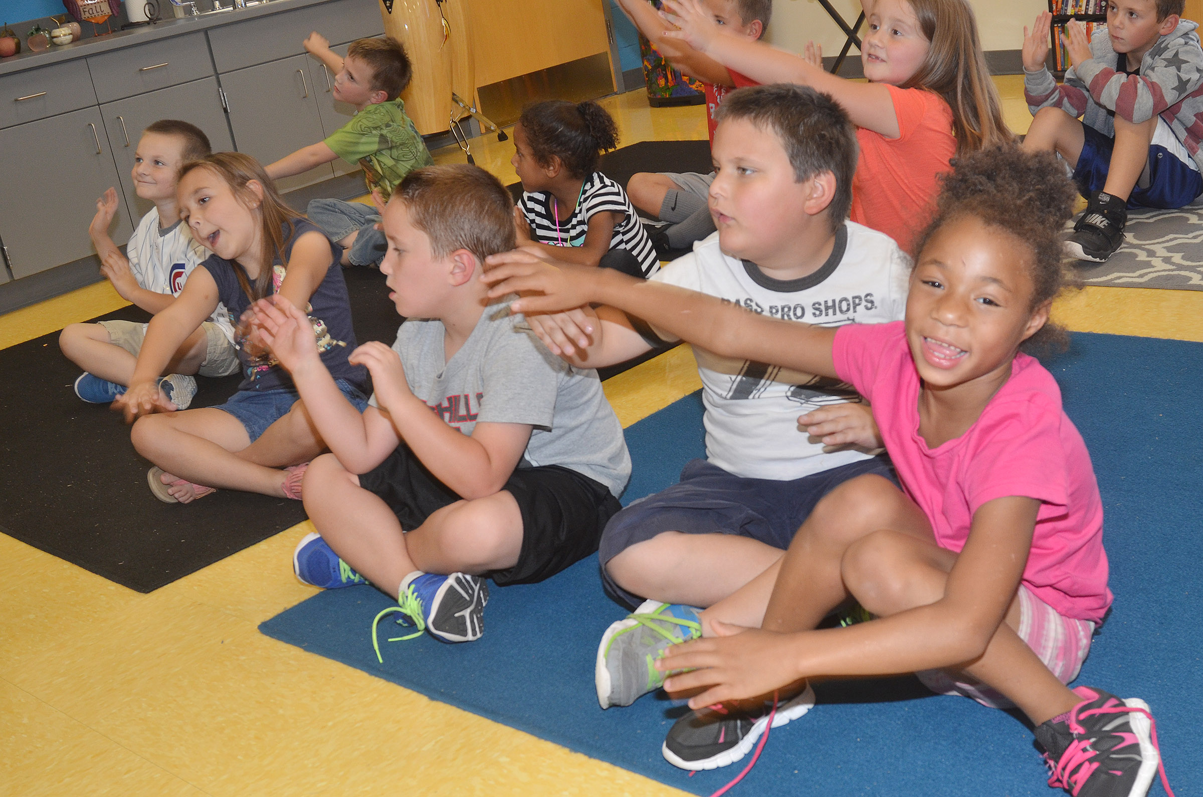 CES first-grader Brea Miller keeps a beat with her classmates.