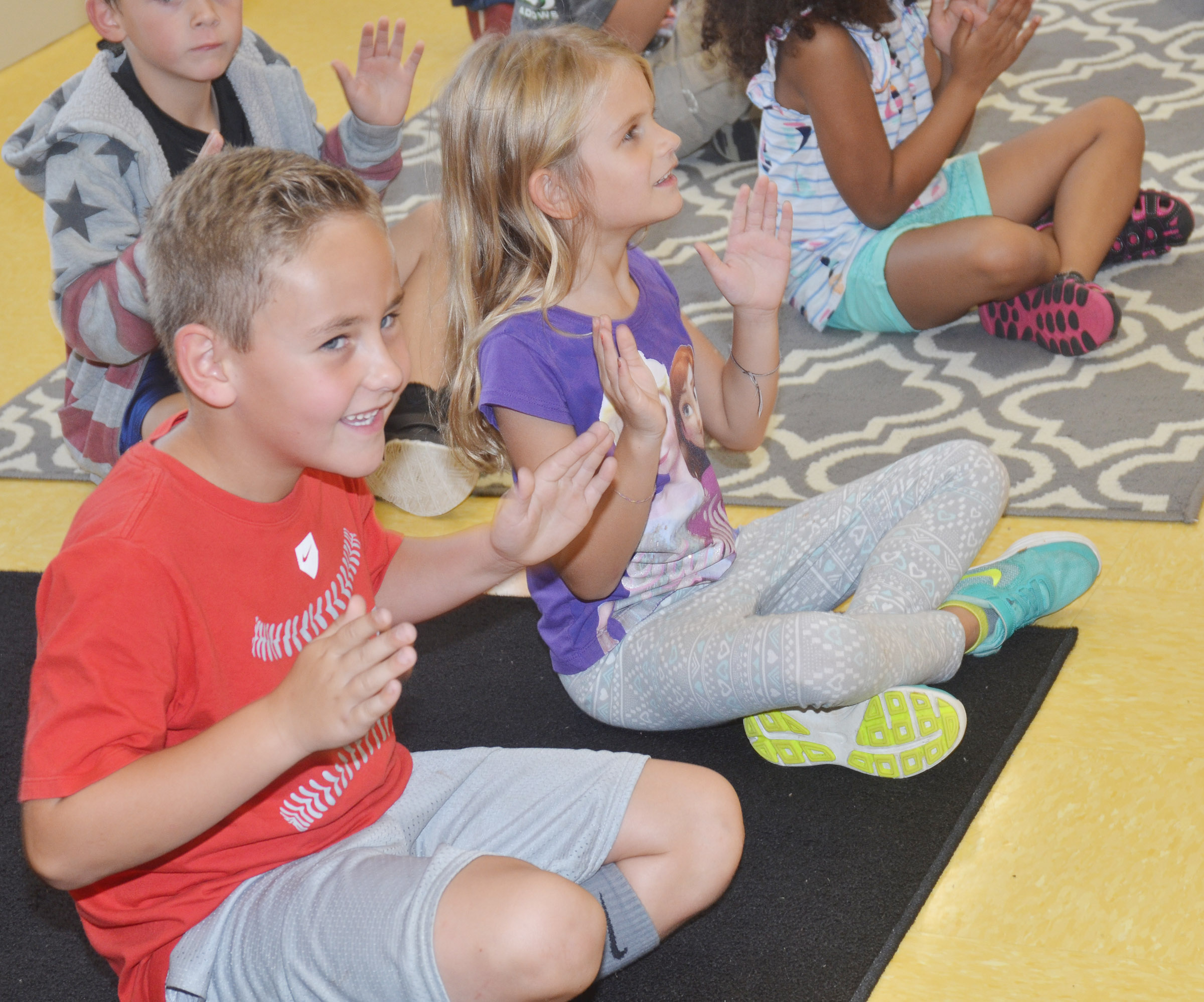 CES first-graders Braxton Rhodes, at left, and Gracie Gebler keep a steady beat.
