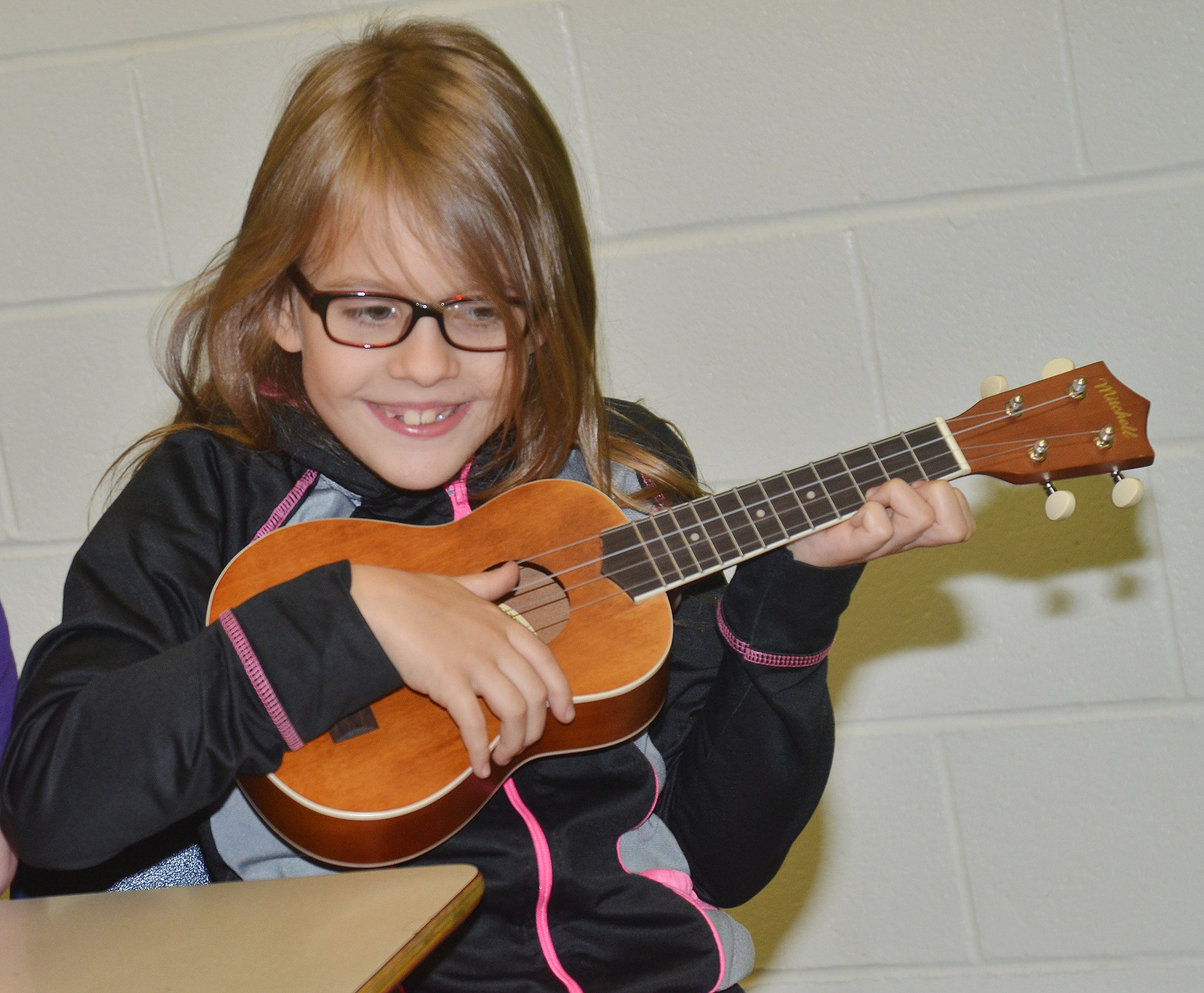 CES fifth-grader Ellie Wise plays a note.