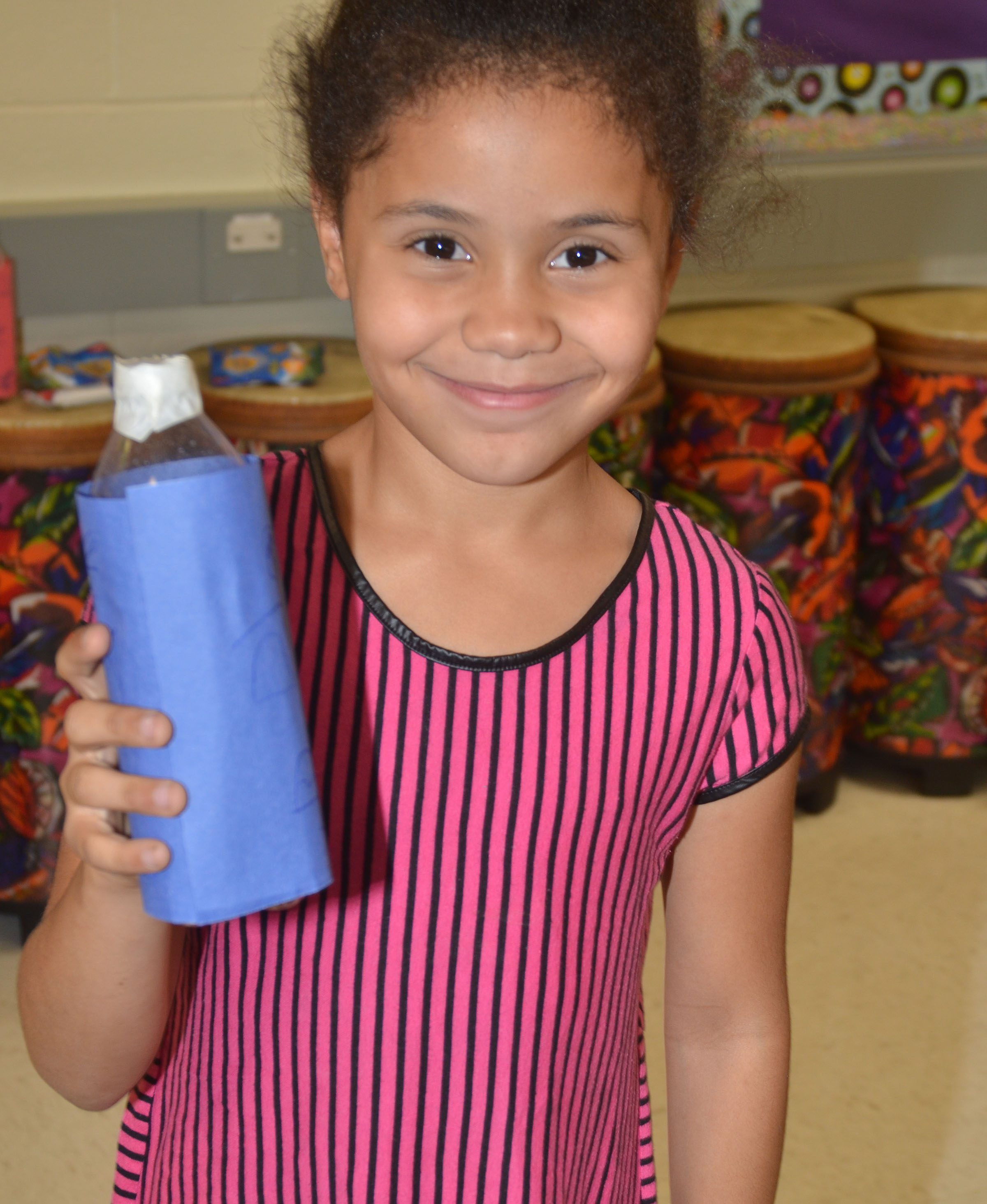 CES second-grader Alex Wilson holds her finished Native American drum rattle.