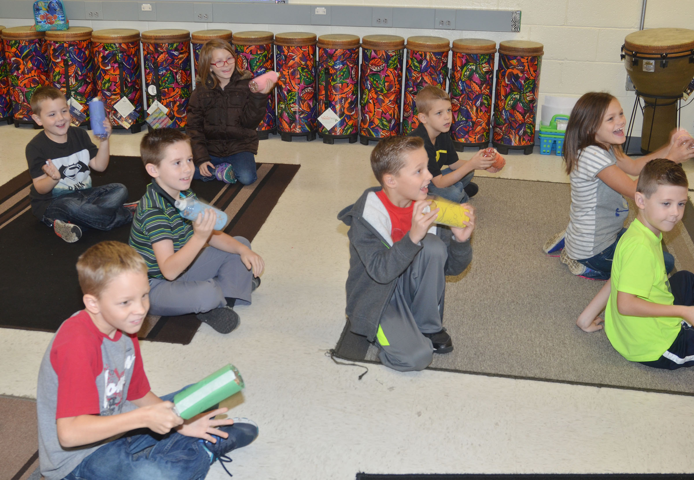 CES second-graders make music with their Native American drum rattles.
