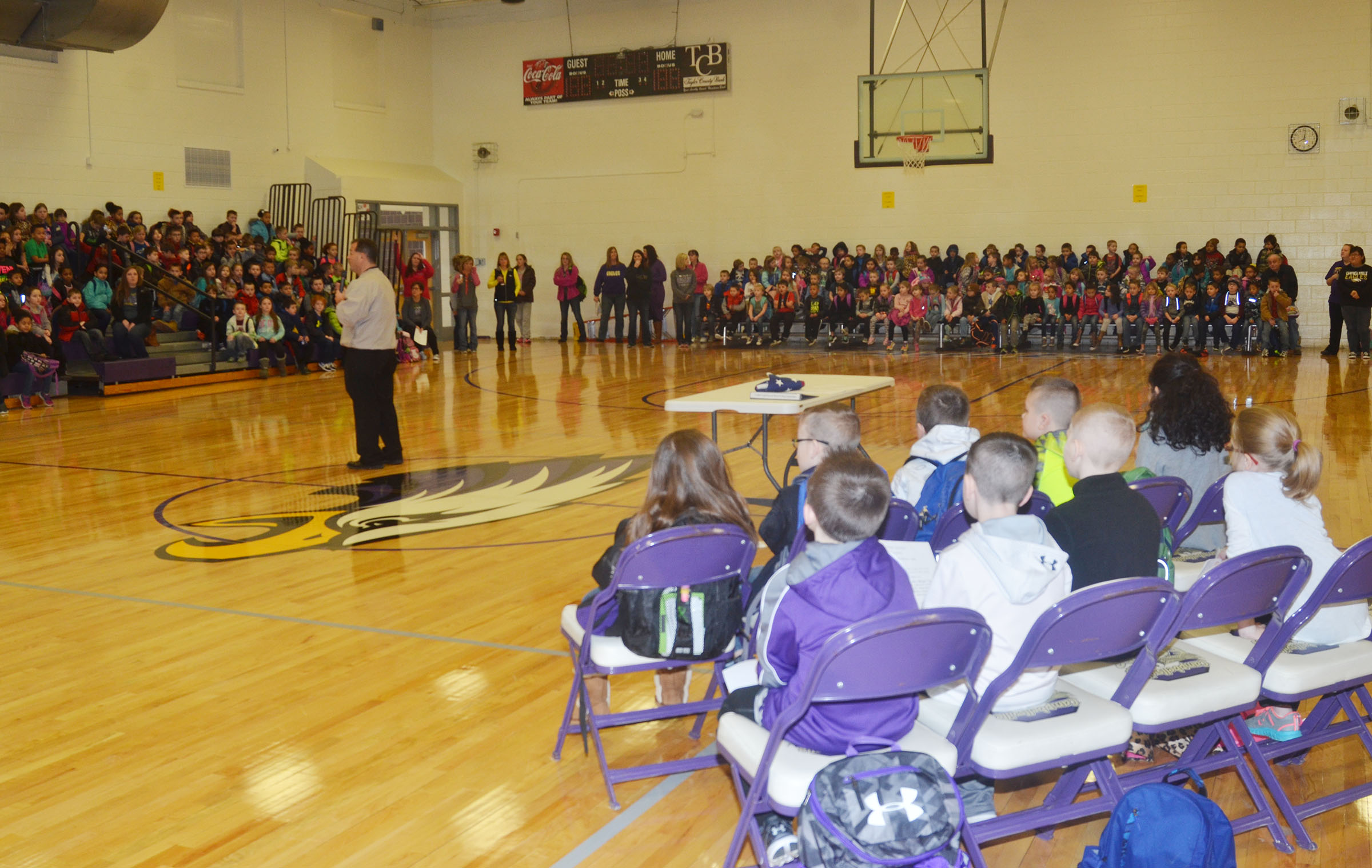 CHS Principal Ricky Hunt talks to students about their new gymnasium.
