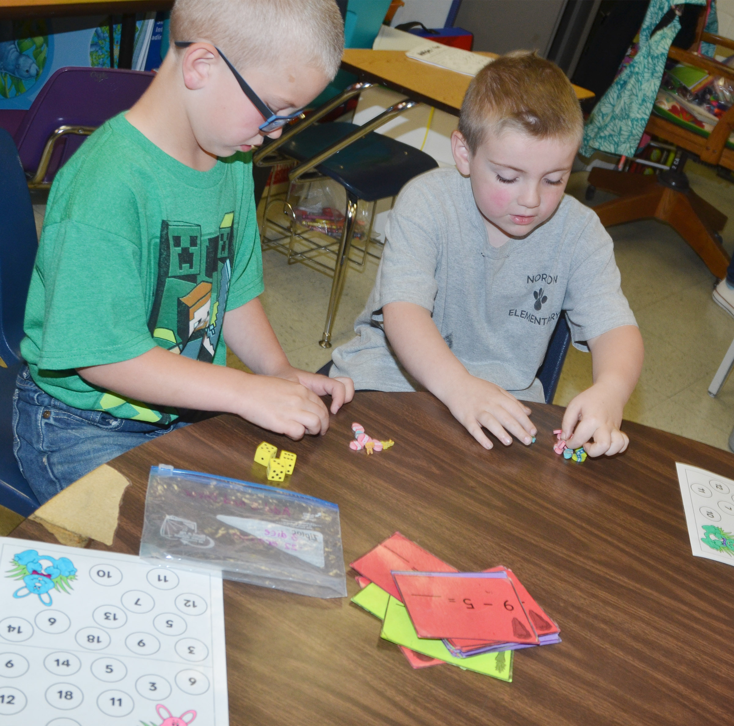 CES first-graders Ethan Bailey, at left, and Drake Edwards play a counting game.