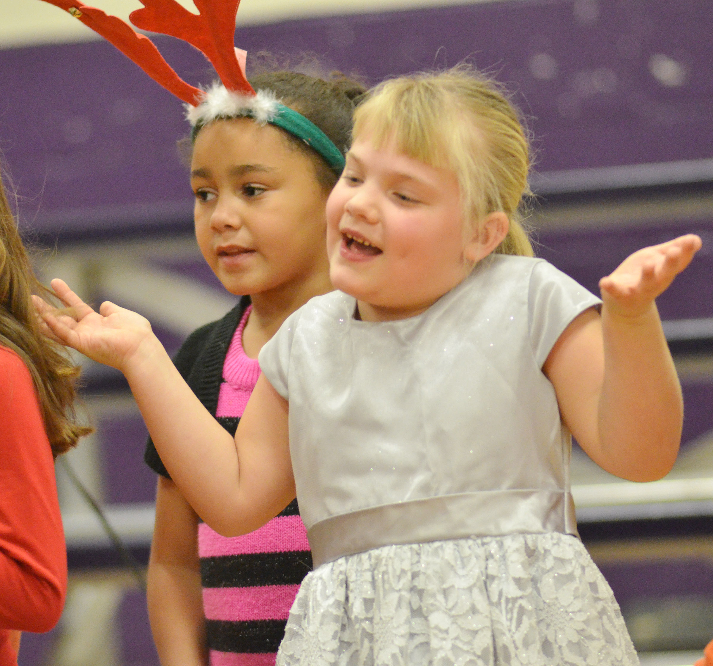 CES first-graders Keitona Whitehead, at left, and Addysen England perform.