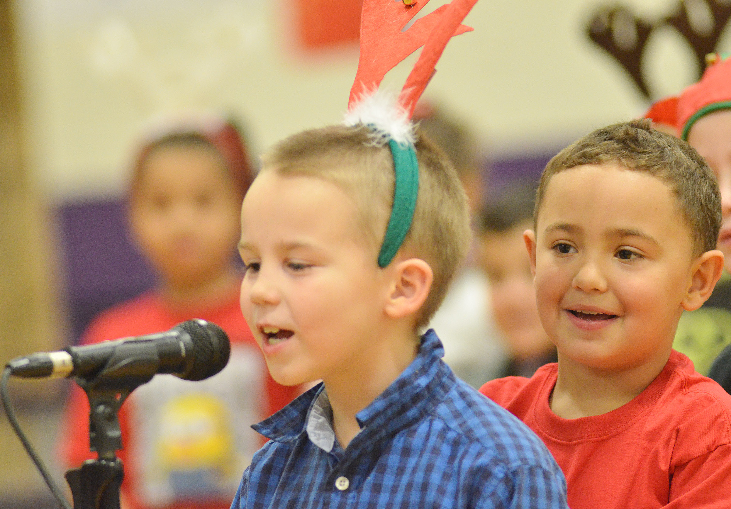 CES first-grader Marion Mann waits his turn as Jackson Bates recites his lines.