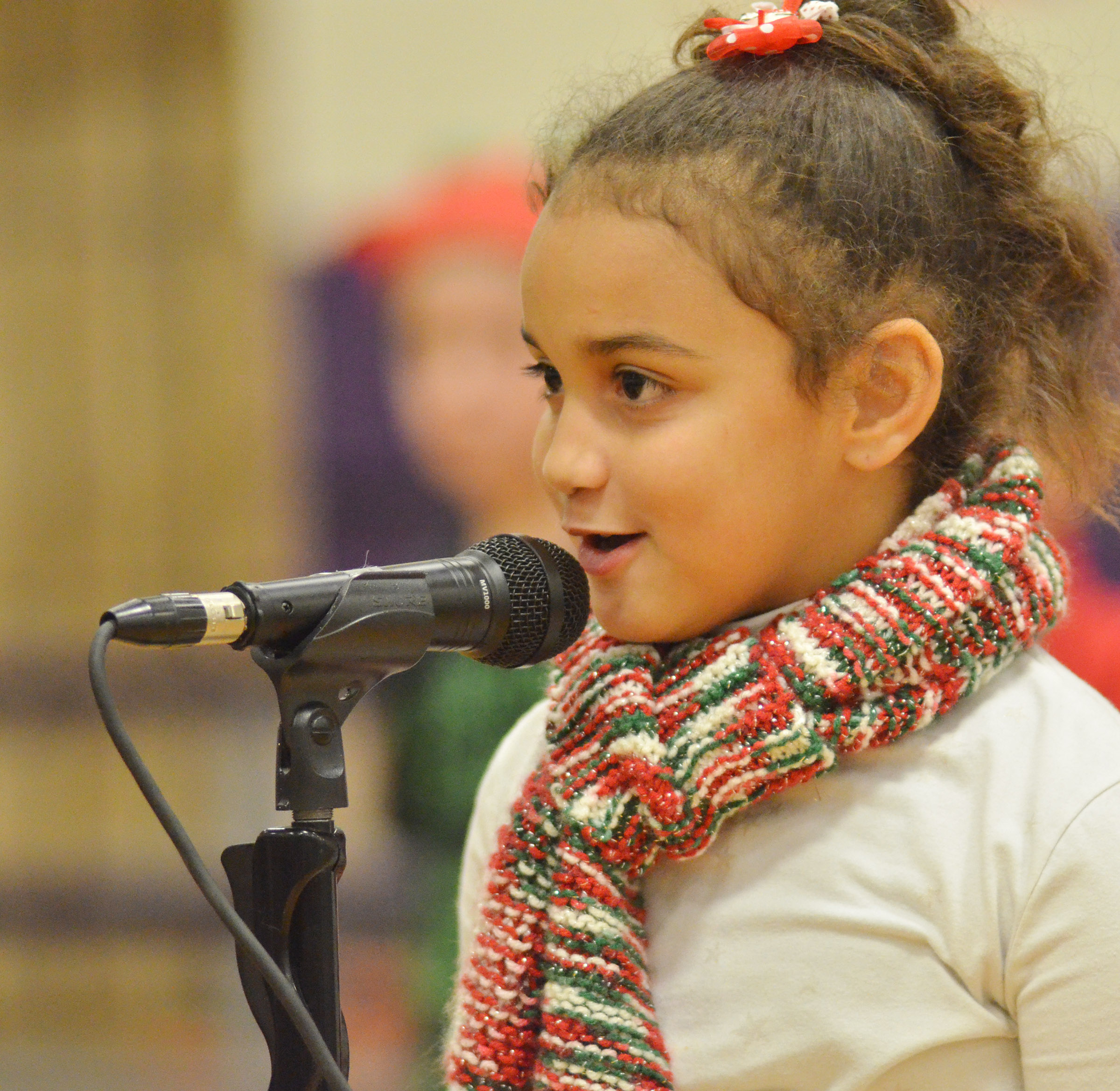 CES first-grader Maleigha Travis talks to the audience.