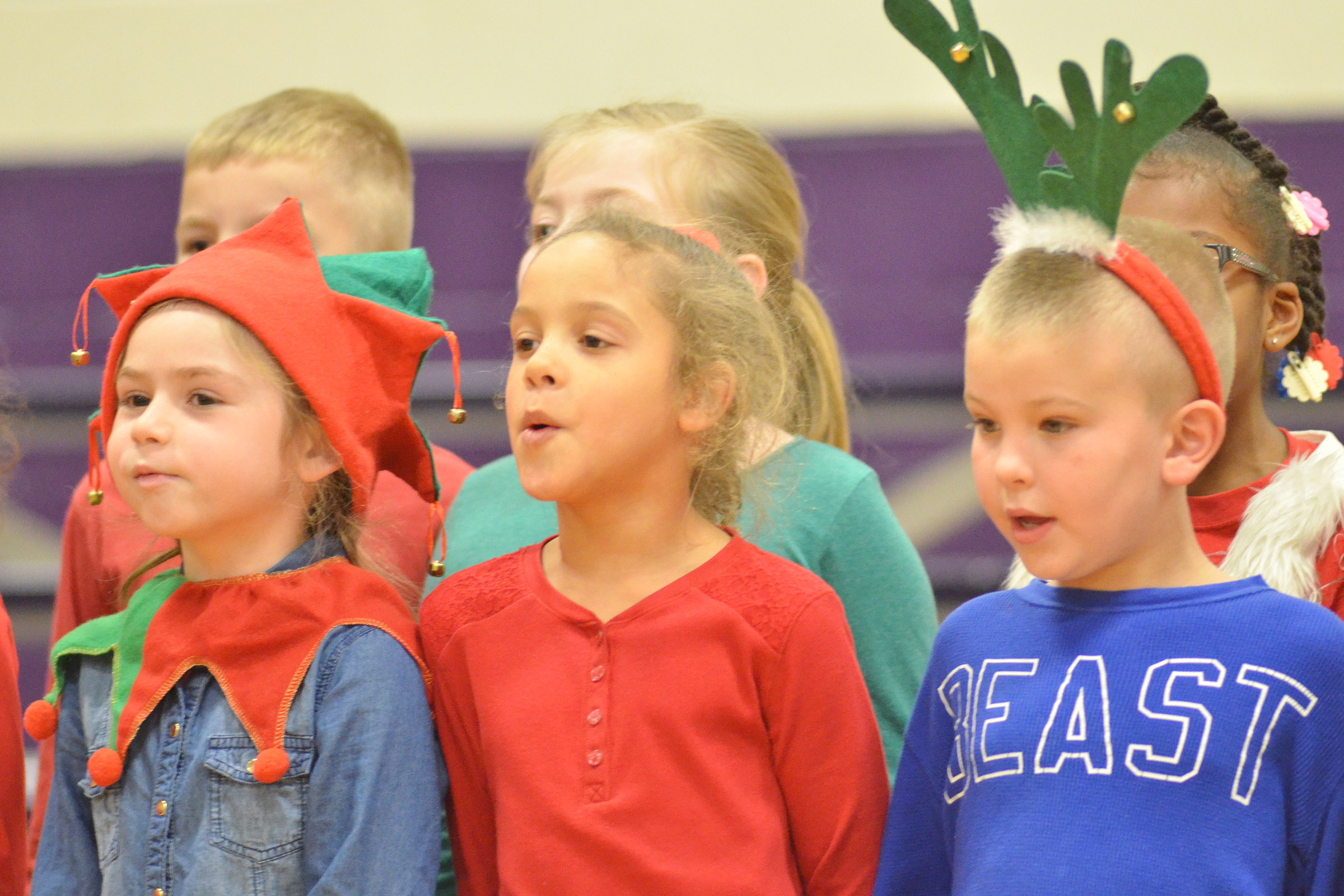 From left, CES first-graders Lainey Price, Keiava Thompson and Ethan Bailey sing.