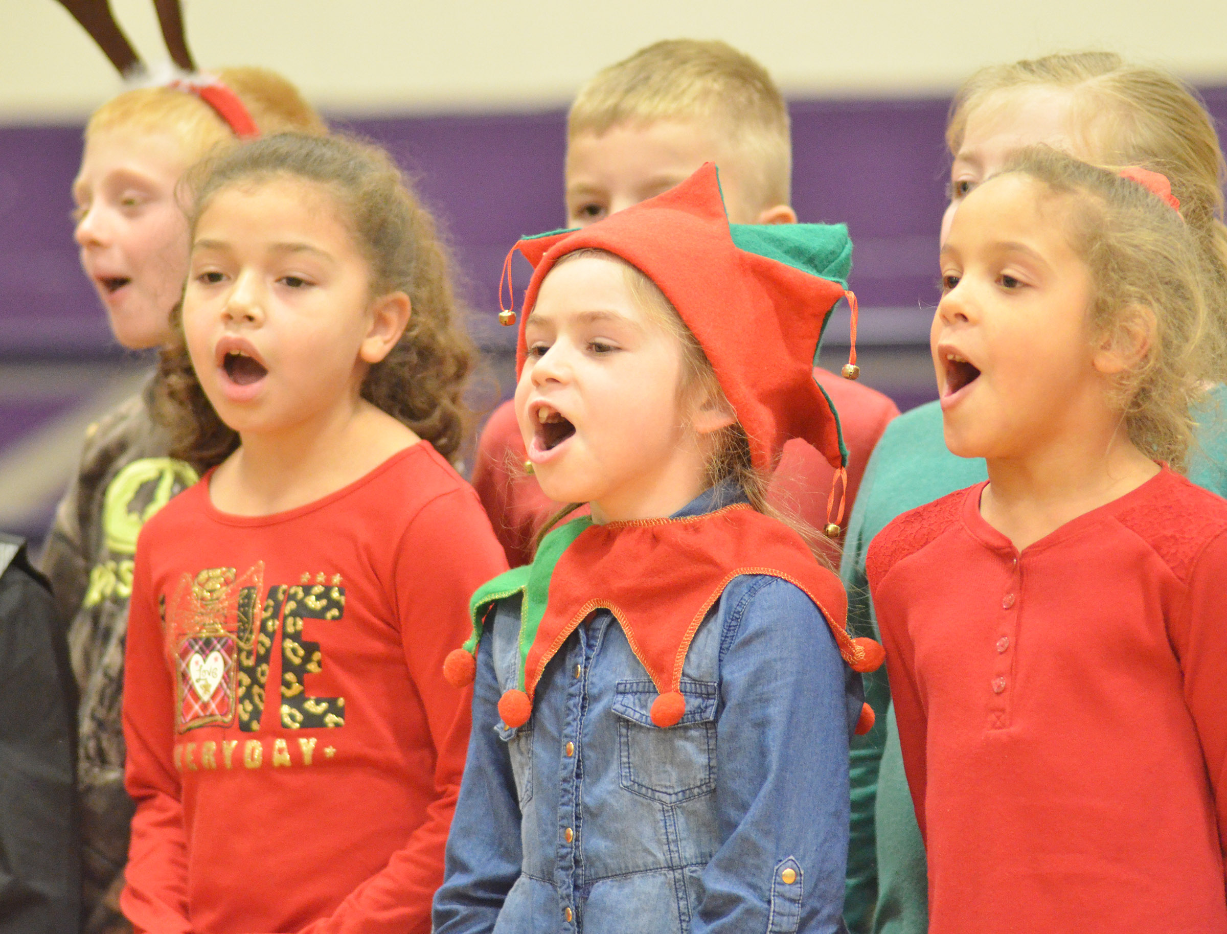 CES first-graders, from left, Ammarissa Nunez, Lainey Price and Keiava Thompson sing.