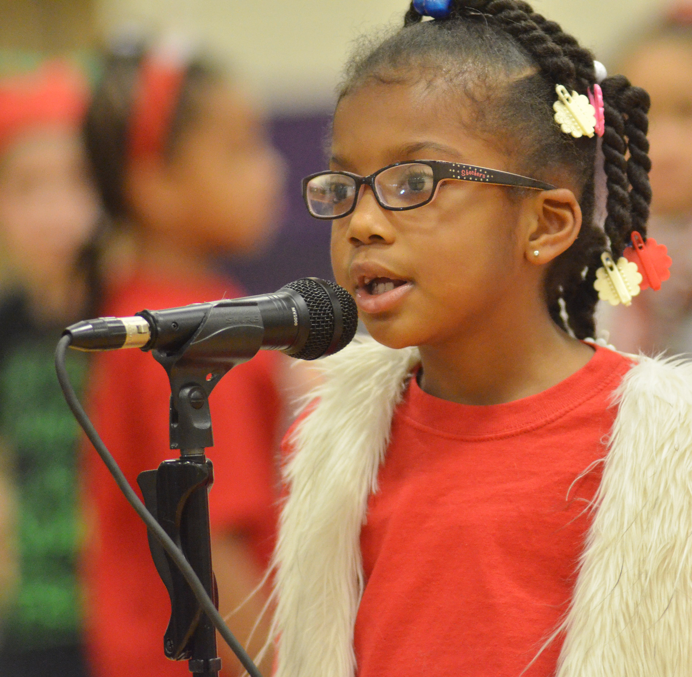 CES first-grader Willow Griffin talks to the audience.
