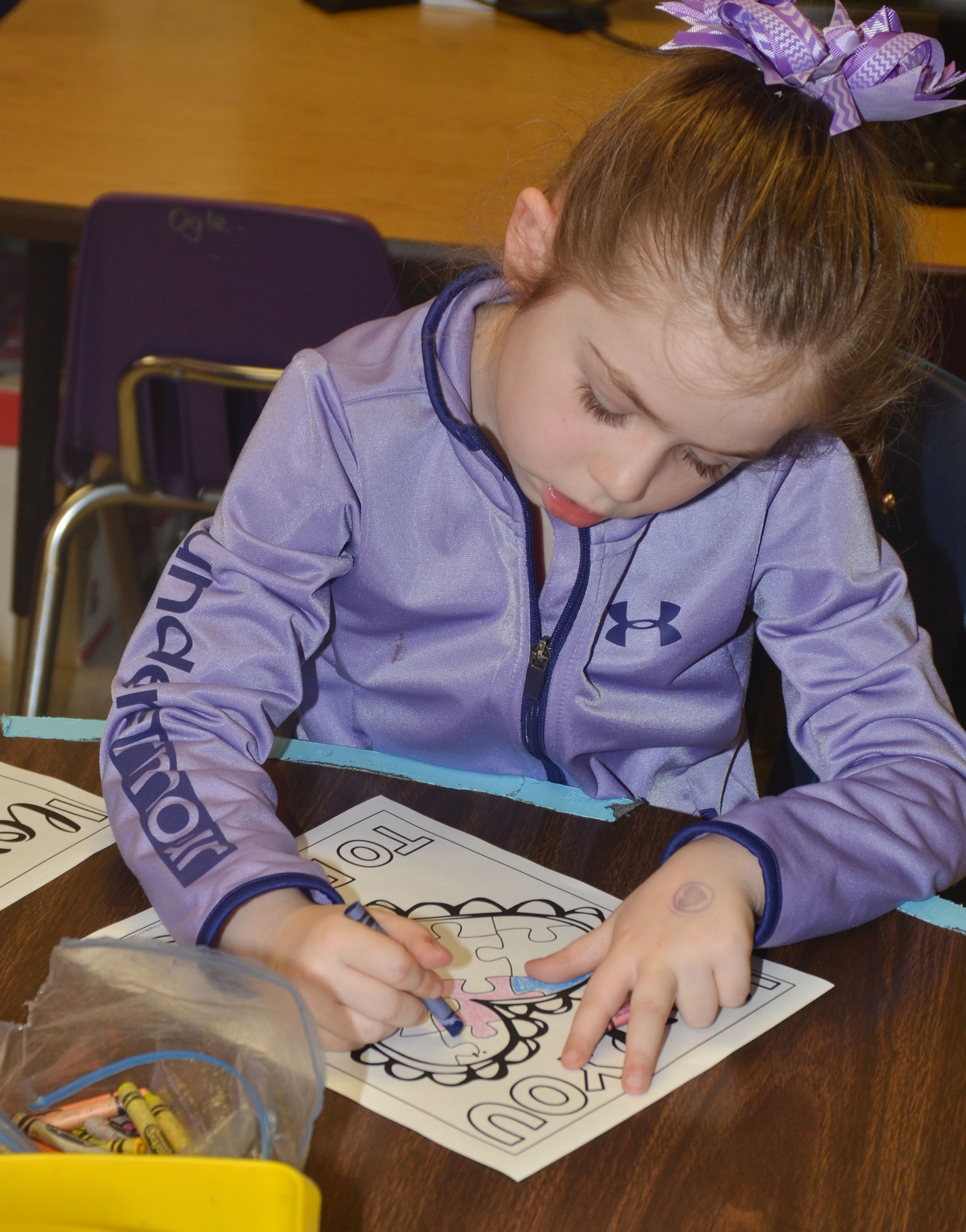 CES first-grader Lainey Price colors a heart.