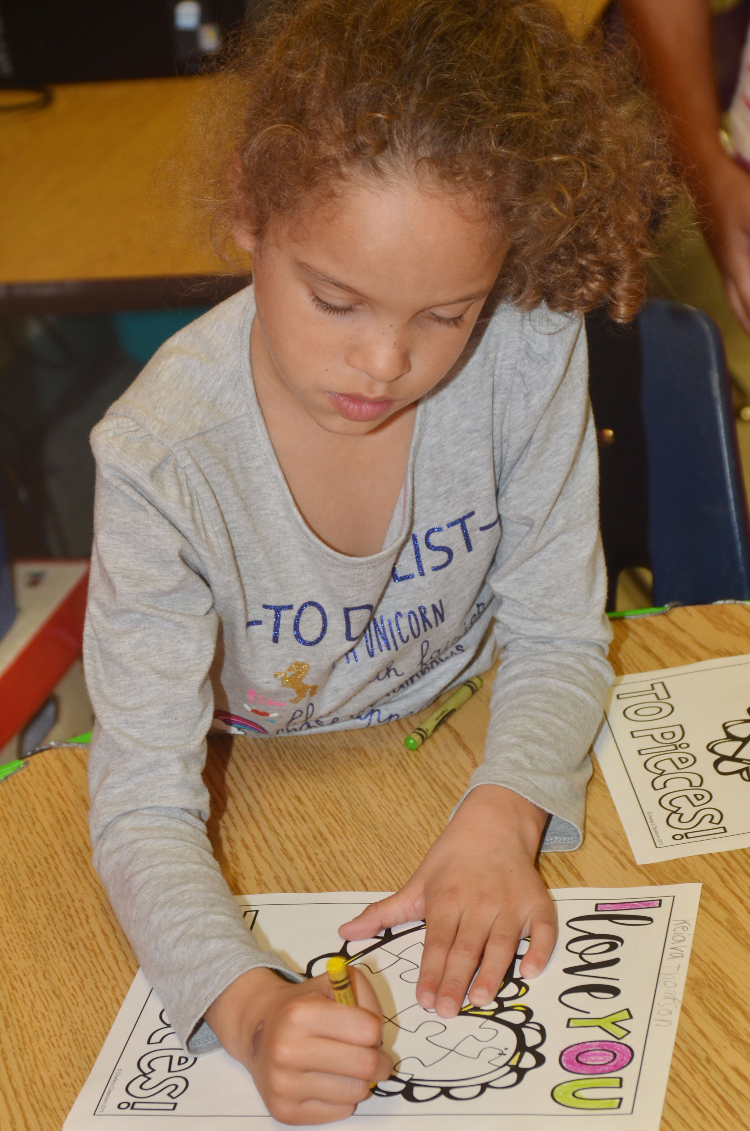 CES first-grader Keiava Thompson colors a heart.
