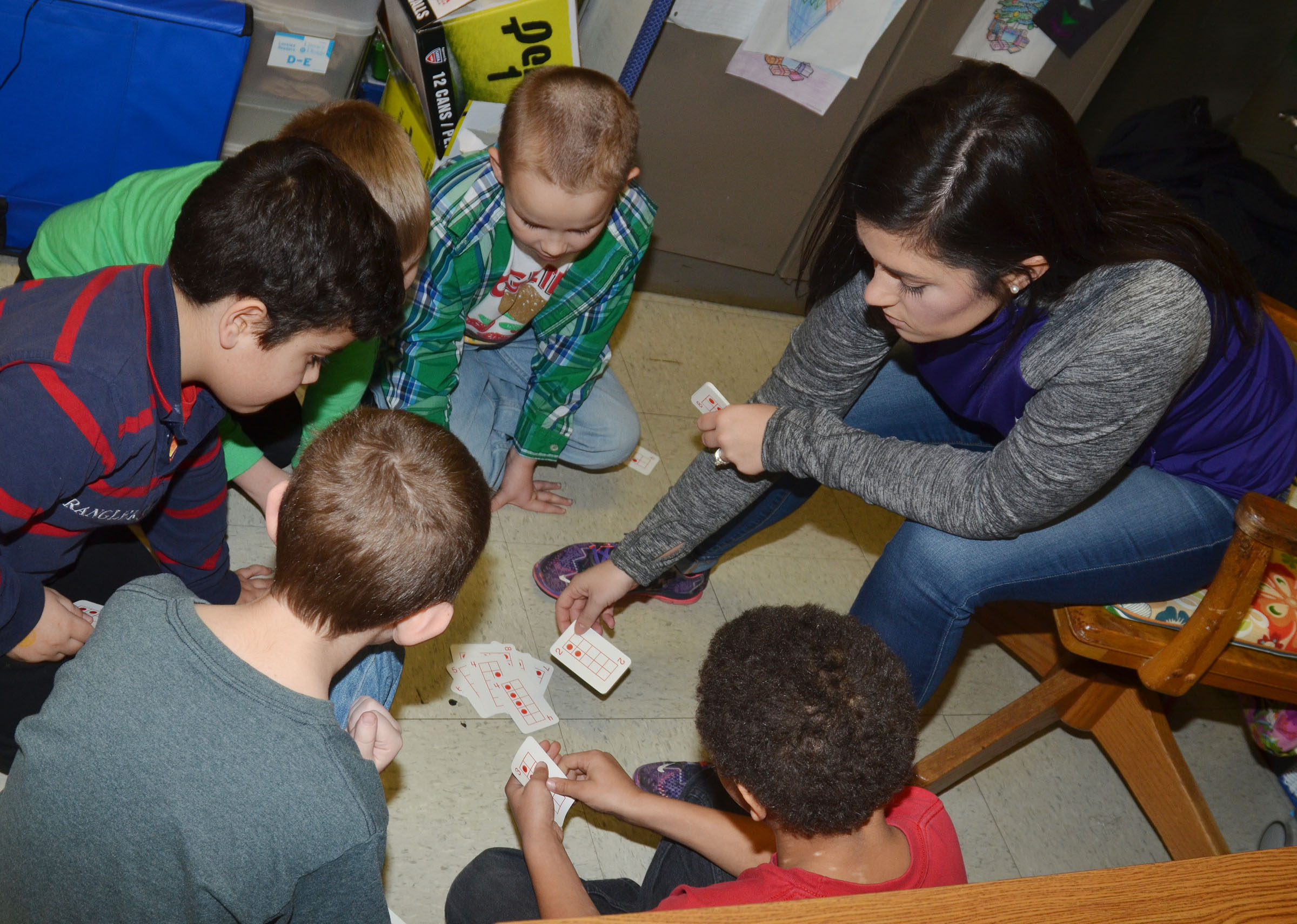 CES first-grade teacher Hailey Ogle plays a counting card game with her students.