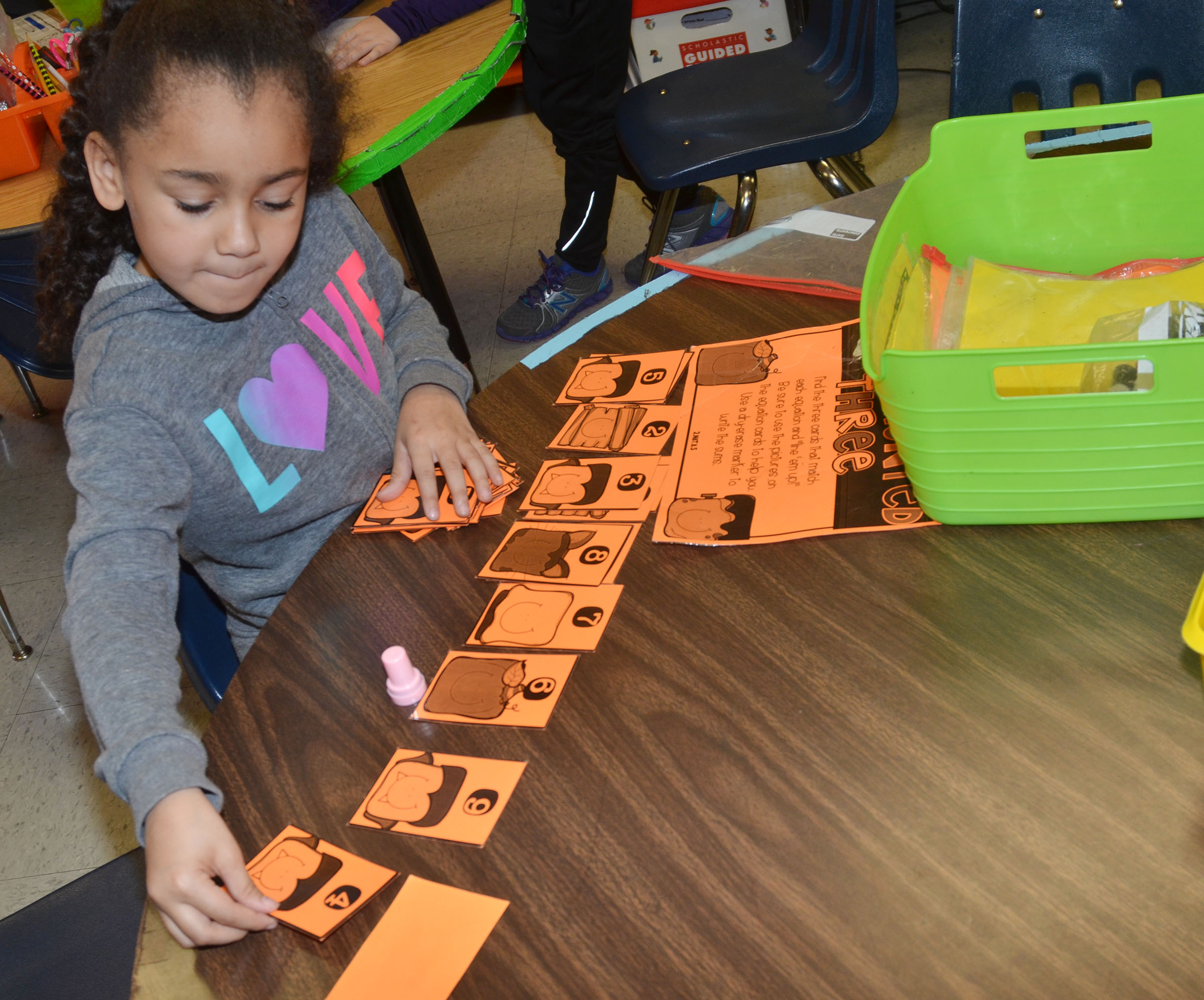 CES first-grader Keitona Whitehead plays a math flashcard game.