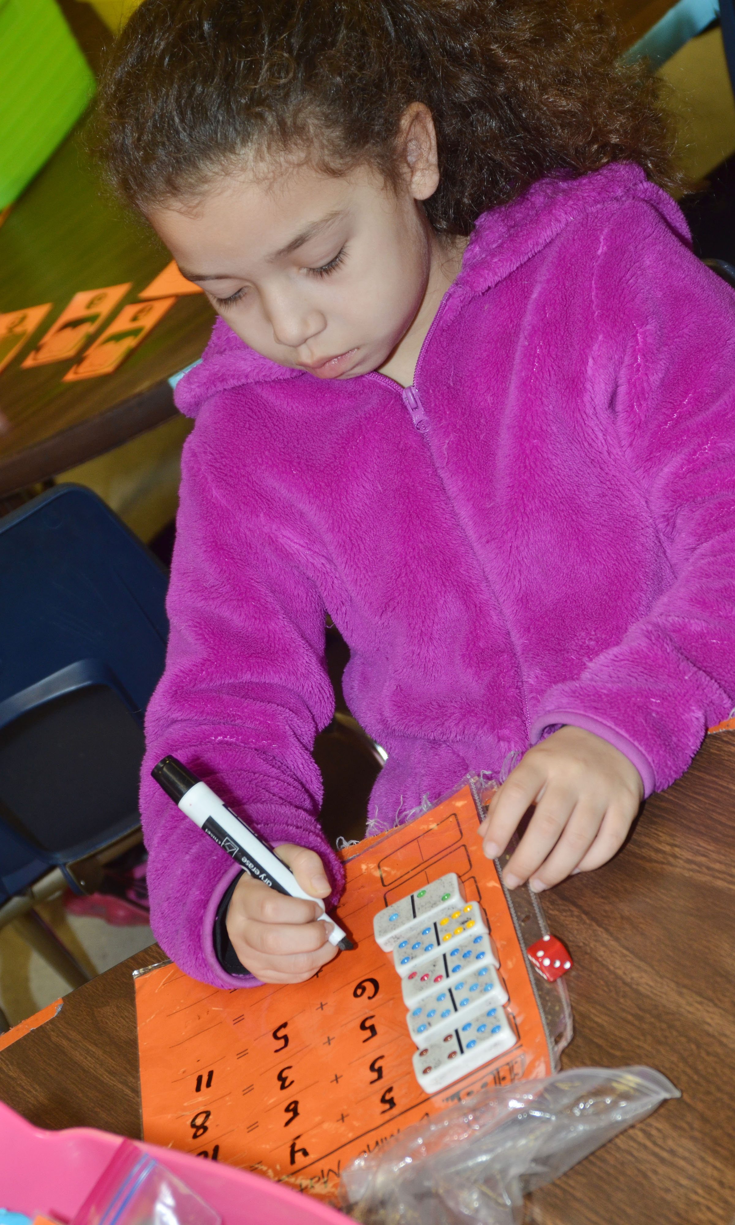 CES first-grader Ammarissa Nunez plays a Dominos math game.