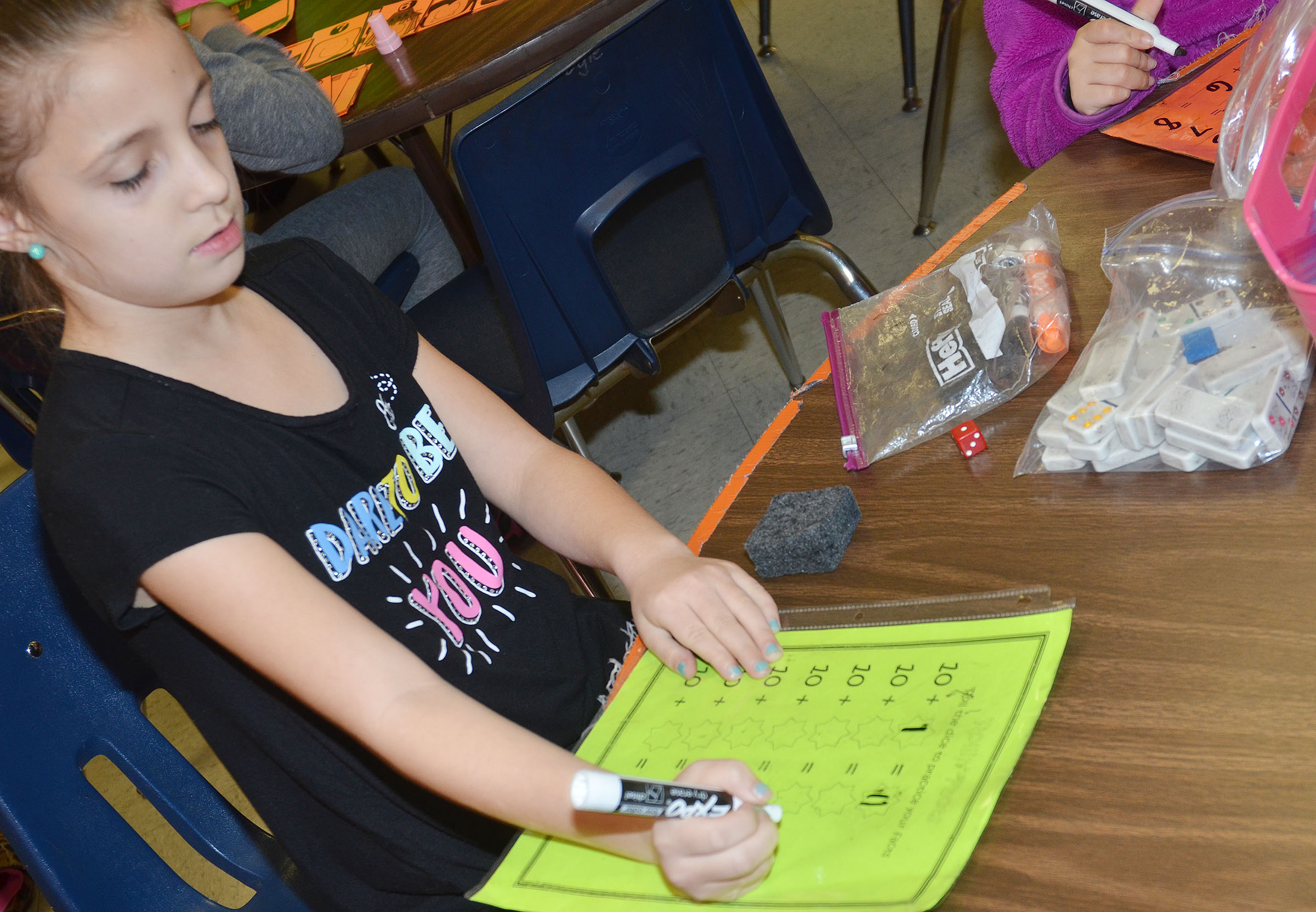 CES first-grader Lillian Martin plays a math dice game to practice addition.