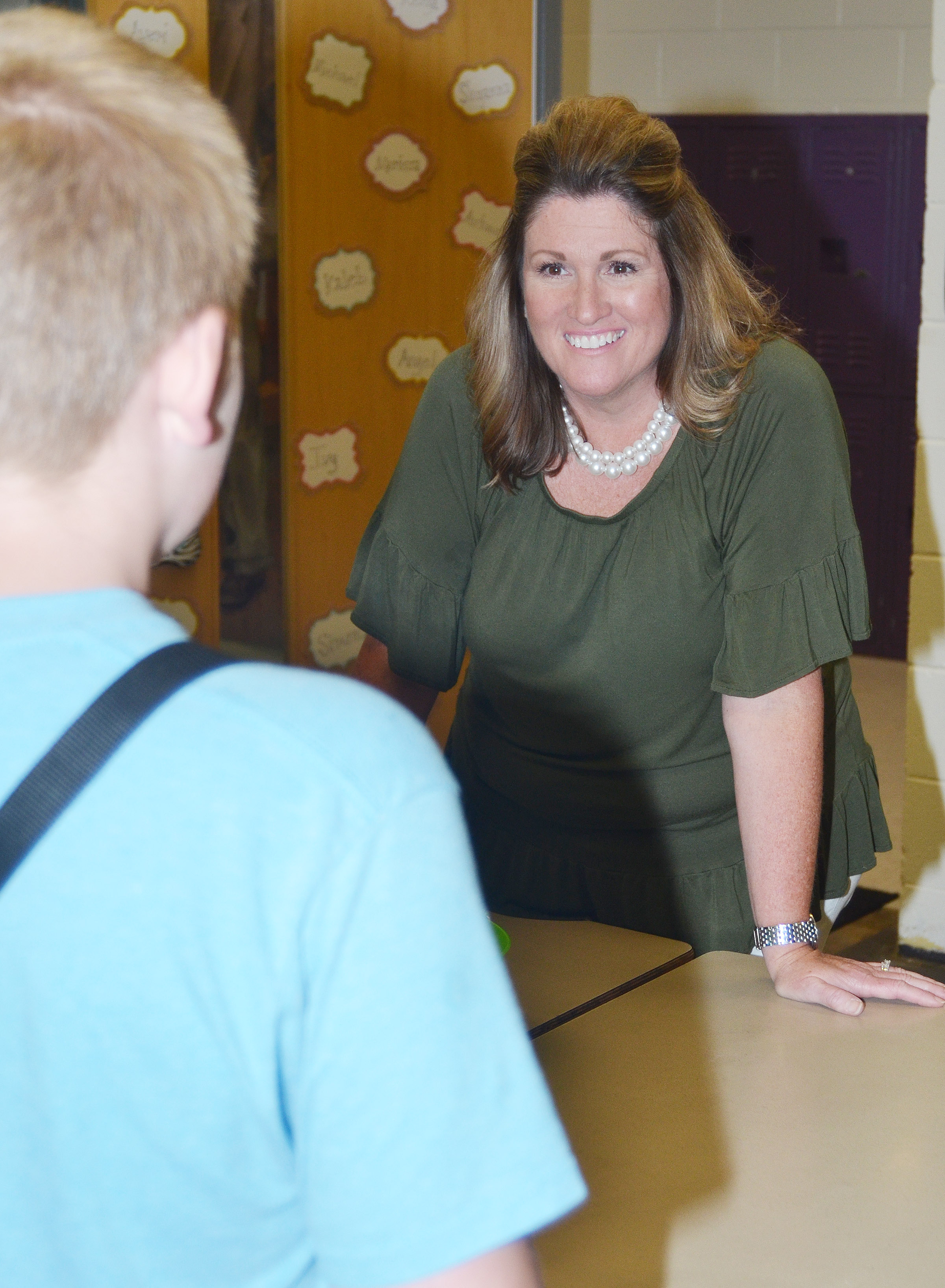 CES fifth-grade teacher Donna White talks to one of her students.
